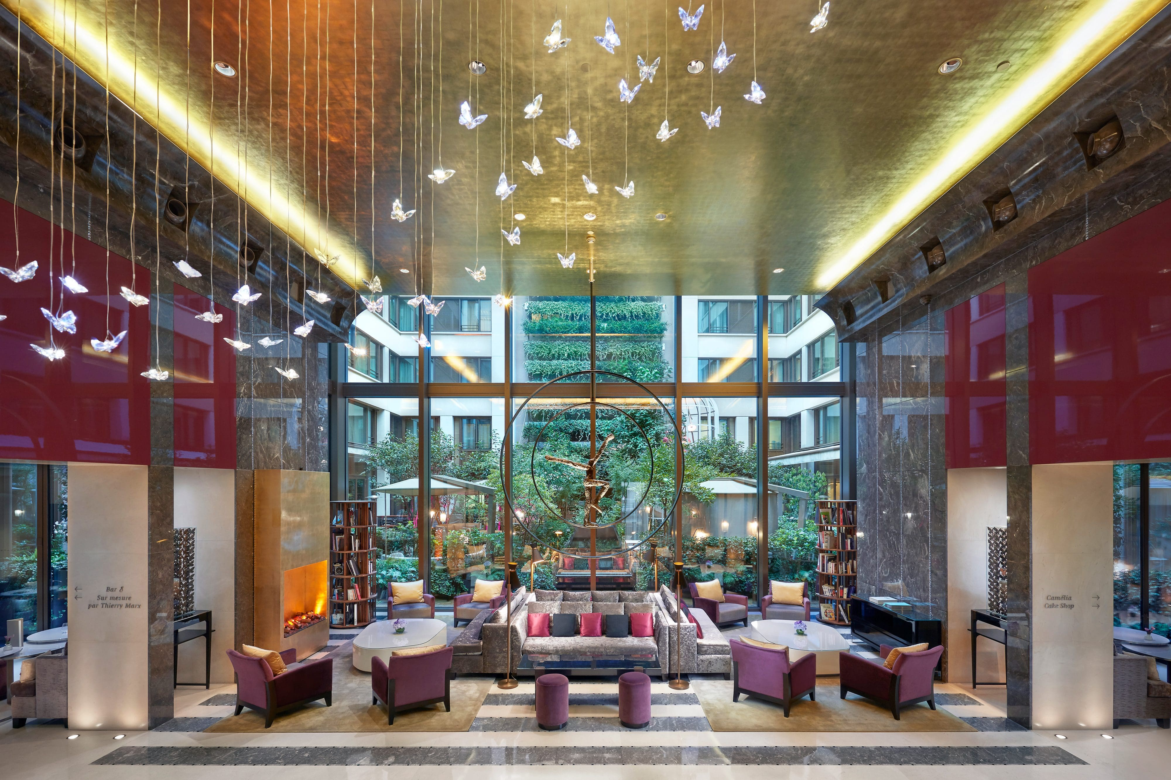 Plush sofas in the Lobby of Mandarin Oriental, Paris with crystal butterflies suspended from the ceiling