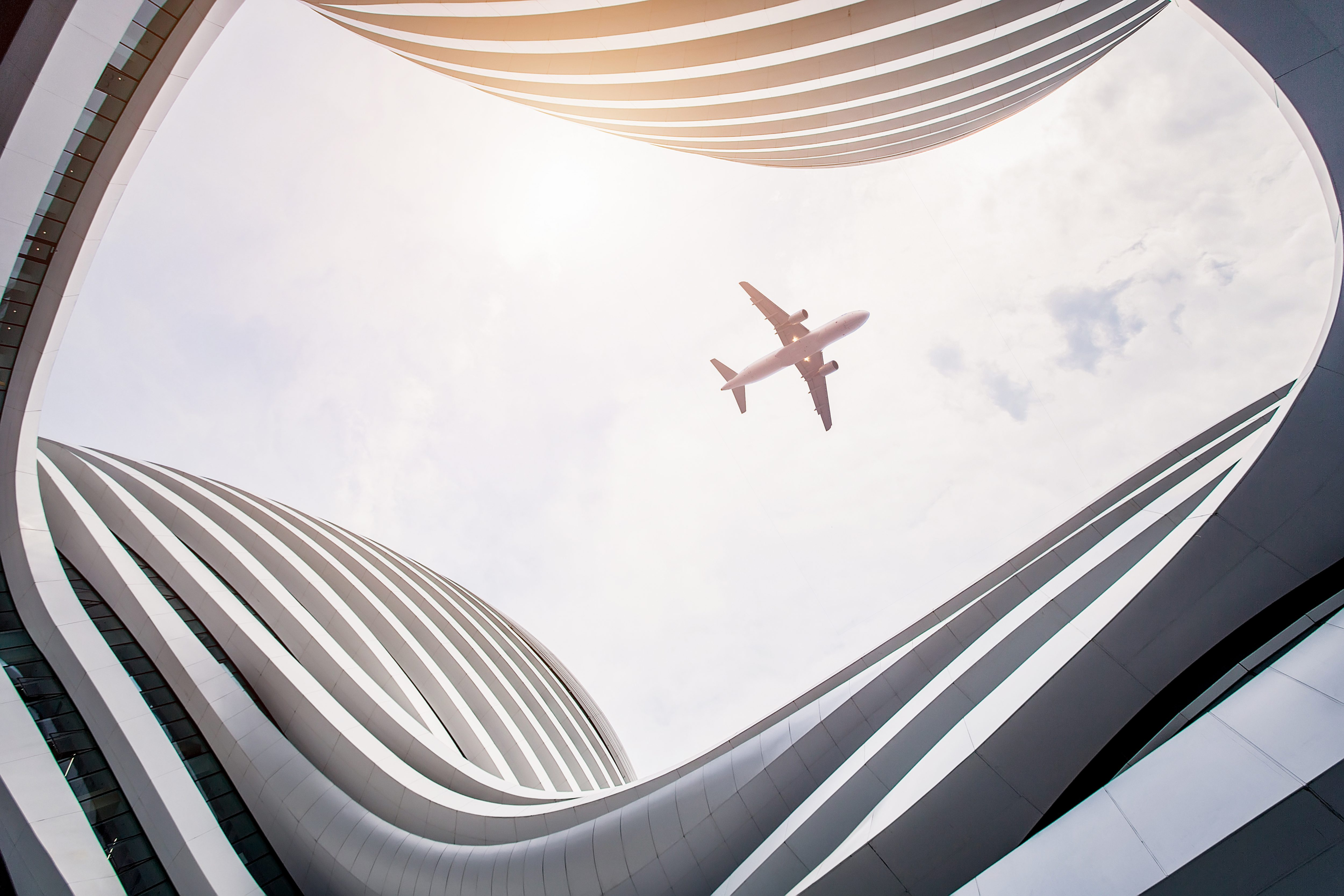 View from the ground looking up at the underside of an aeroplane