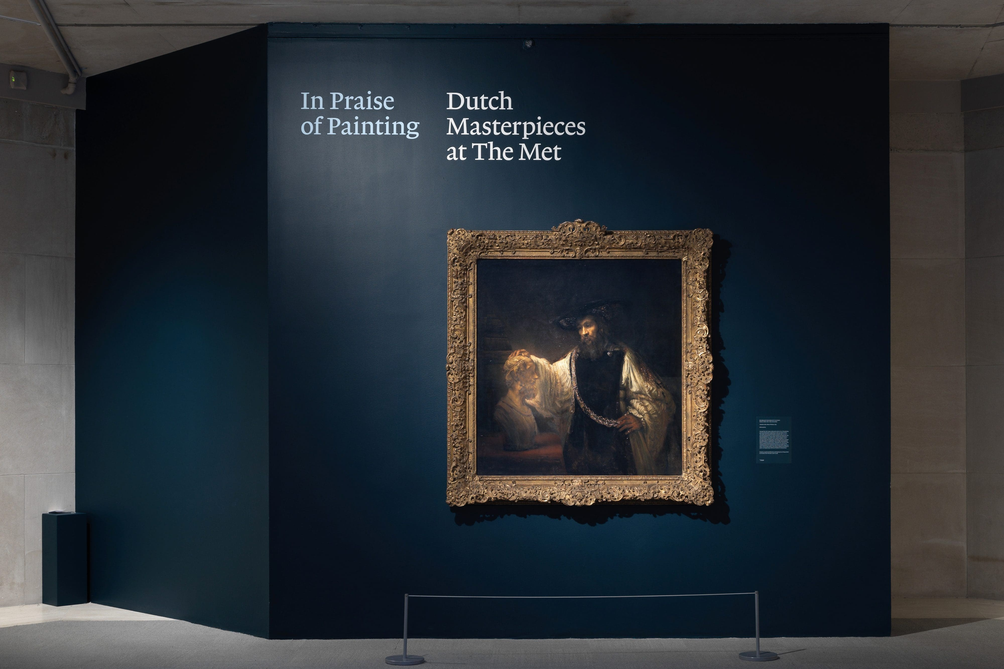 A Dutch Golden Age masterpiece painting hanging on The Met's dark blue wall