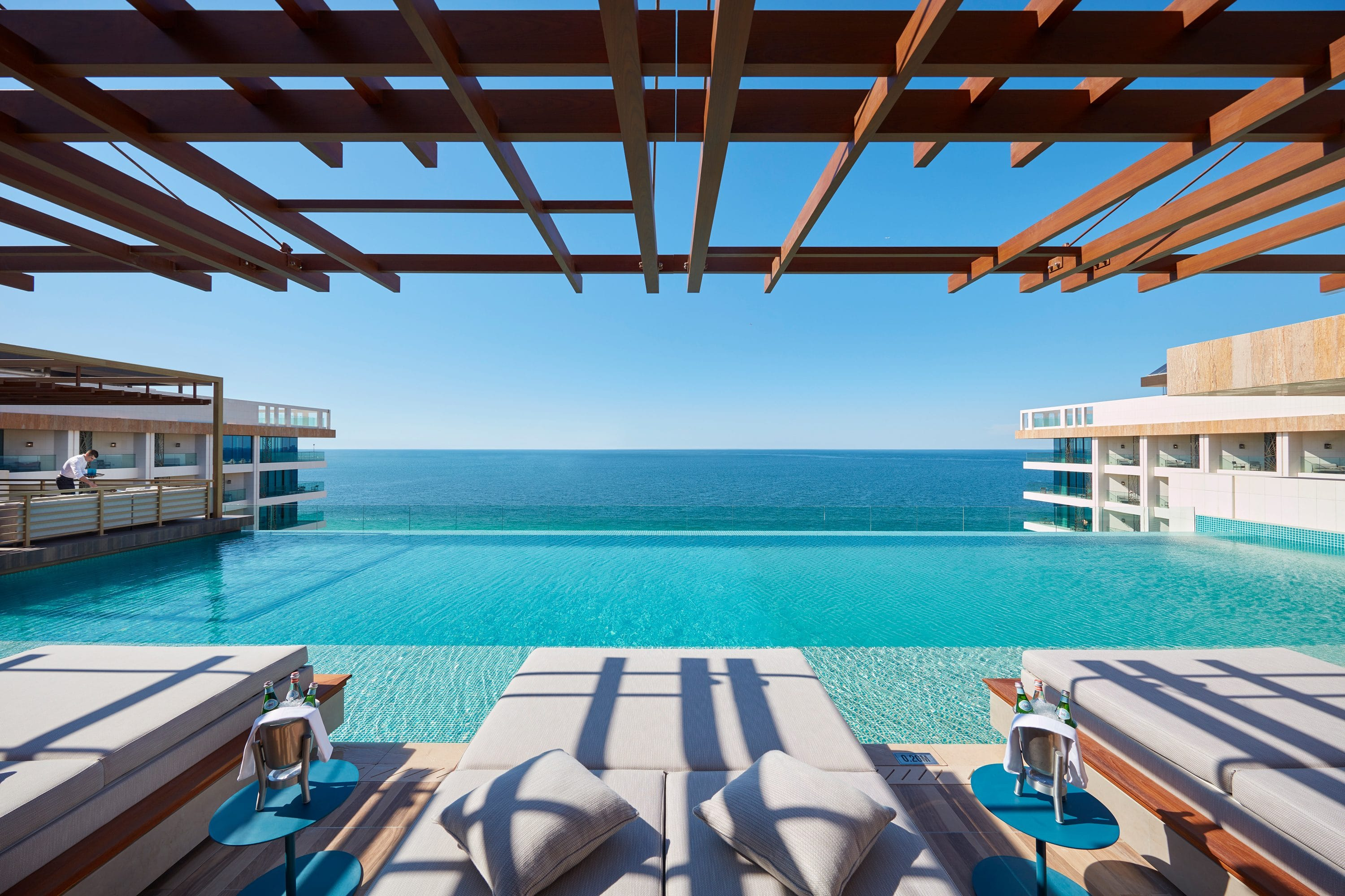 View of the rooftop infinity pool from Tasca at Mandarin Oriental