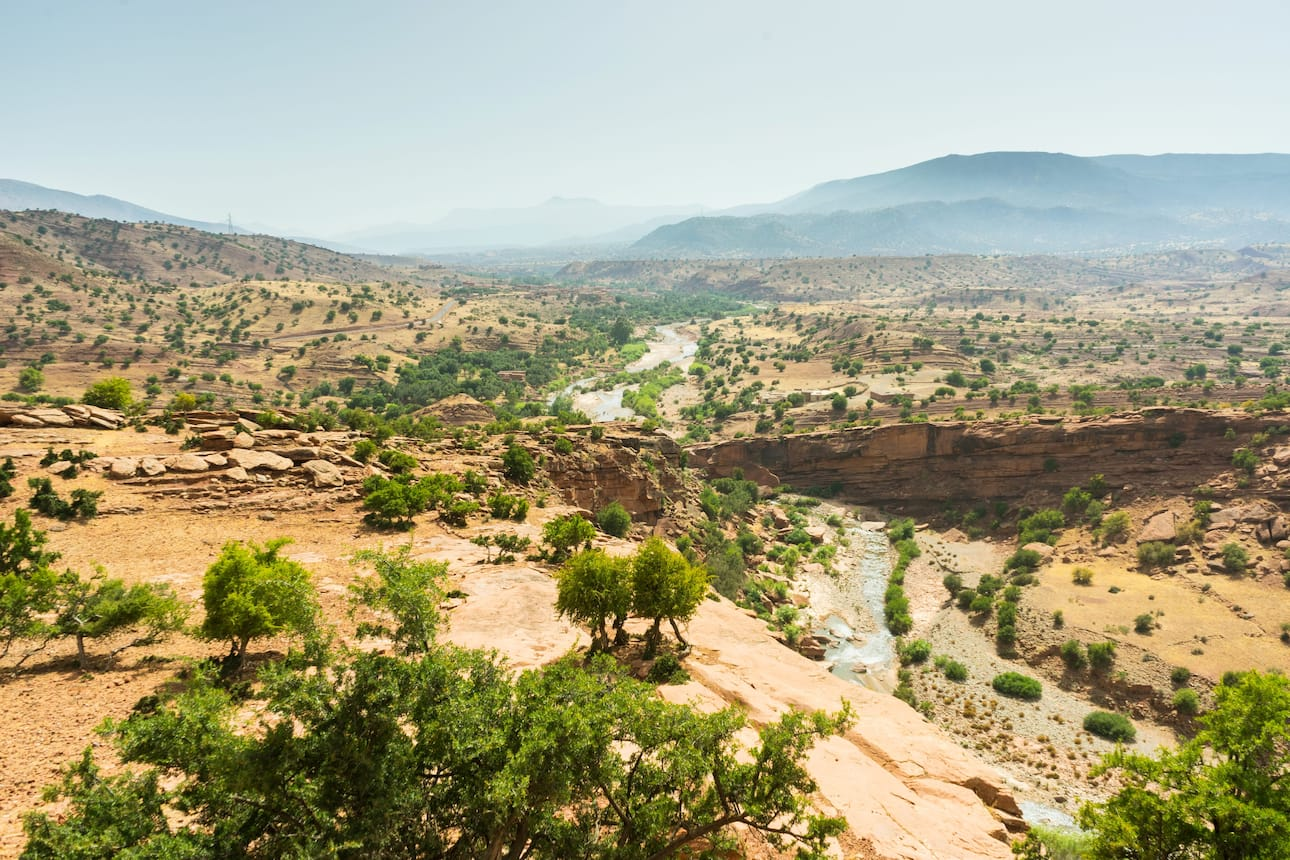 Arid mountains of Morocco with green trees dotted around