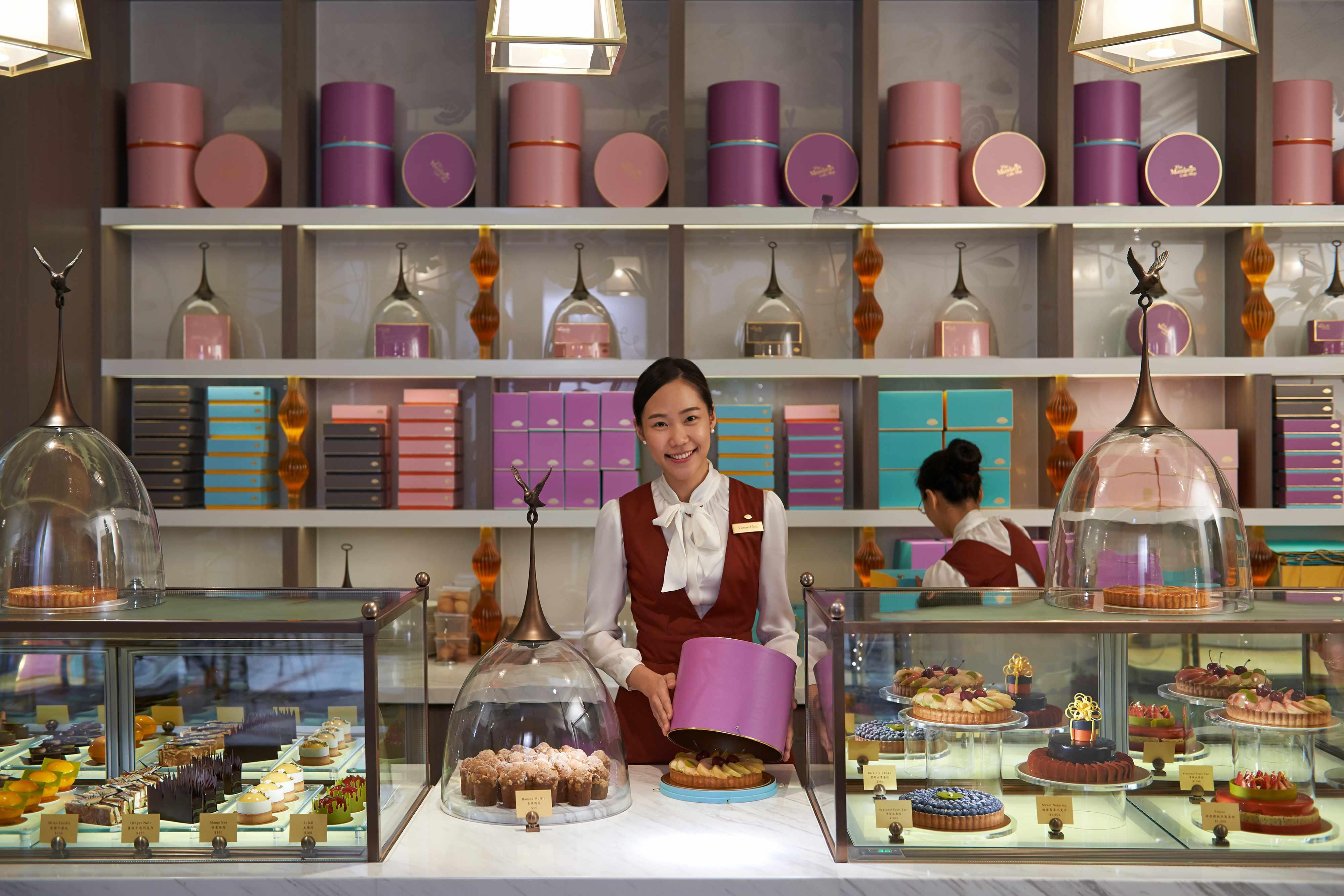 Woman working inside The Mandarin Cake Shop at Mandarin Oriental, Taipei