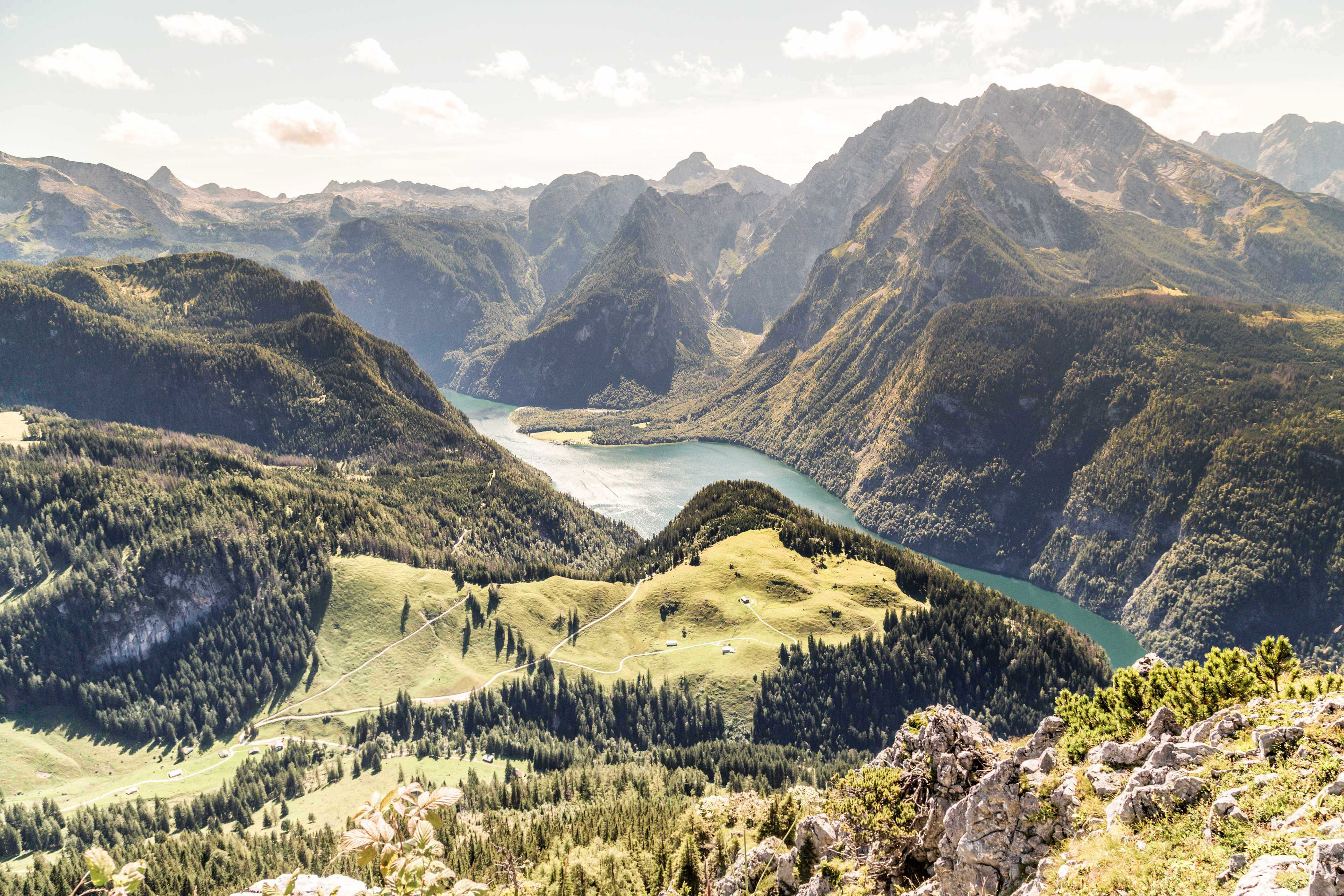 Peering out over the water from a grassy peak in Berchtesgaden National Park