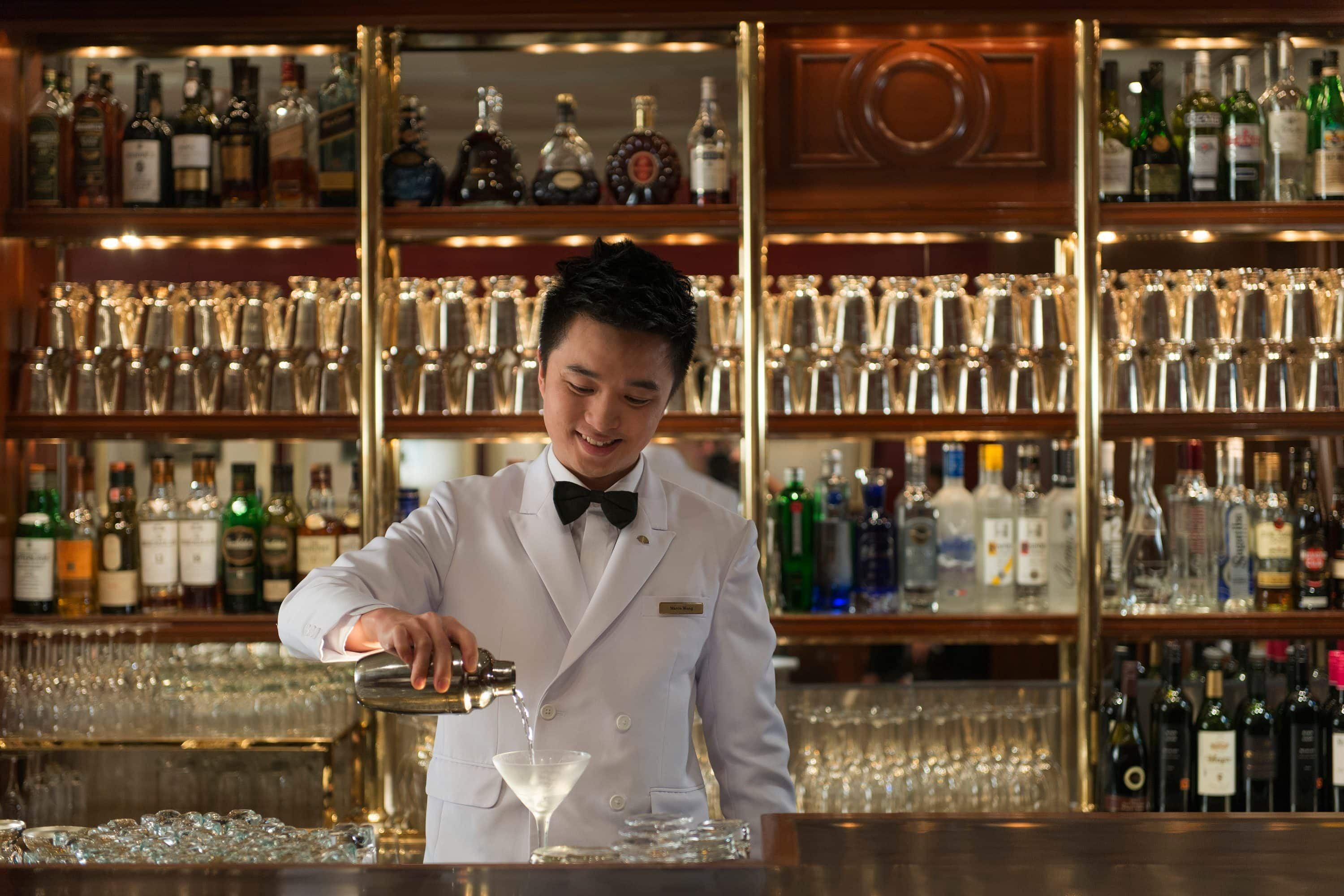 A bartender prepares a drink at the Captain's Bar, Mandarin Oriental, Hong Kong