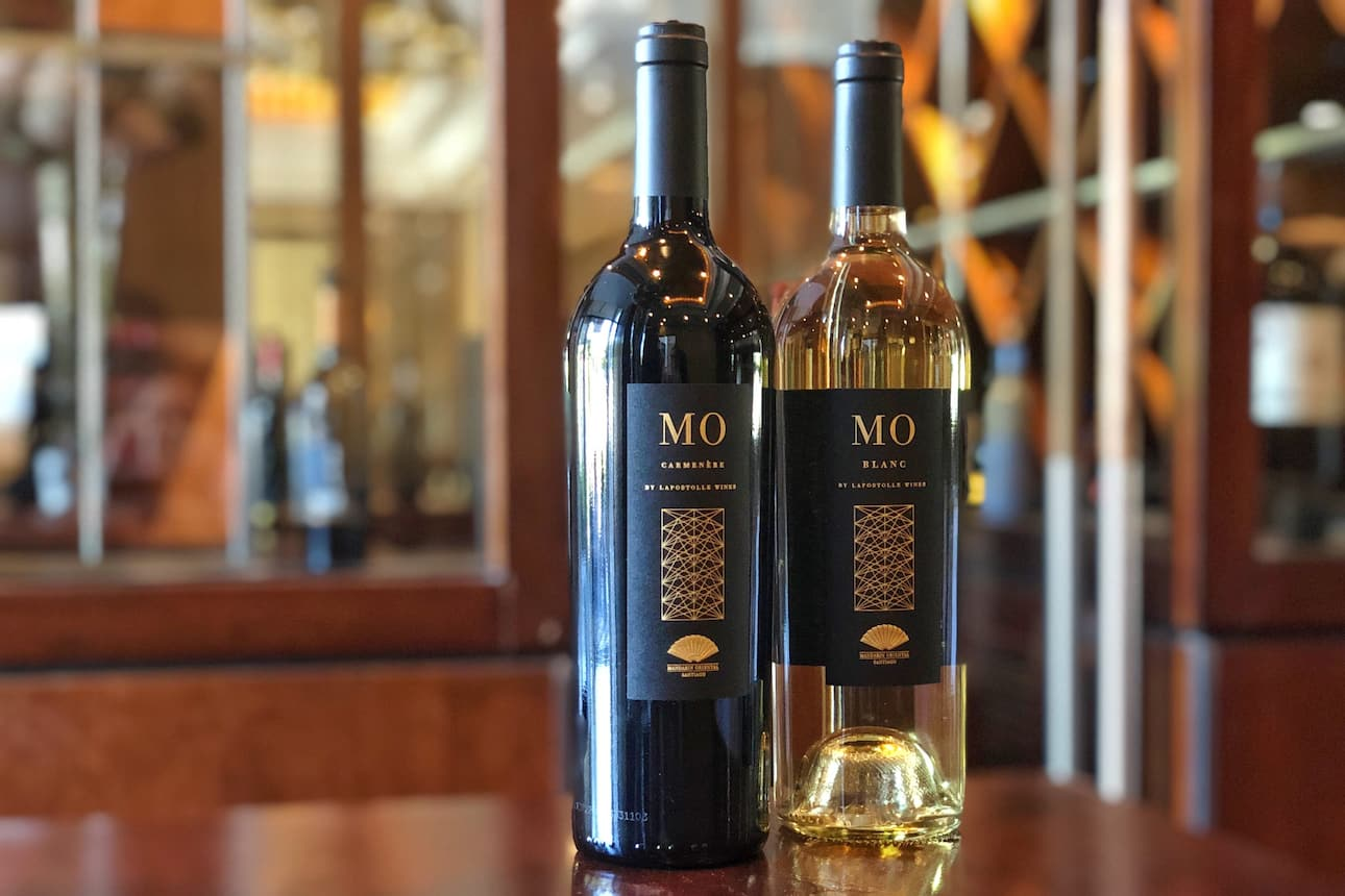Bottles of MO Carménère and MO Blanc