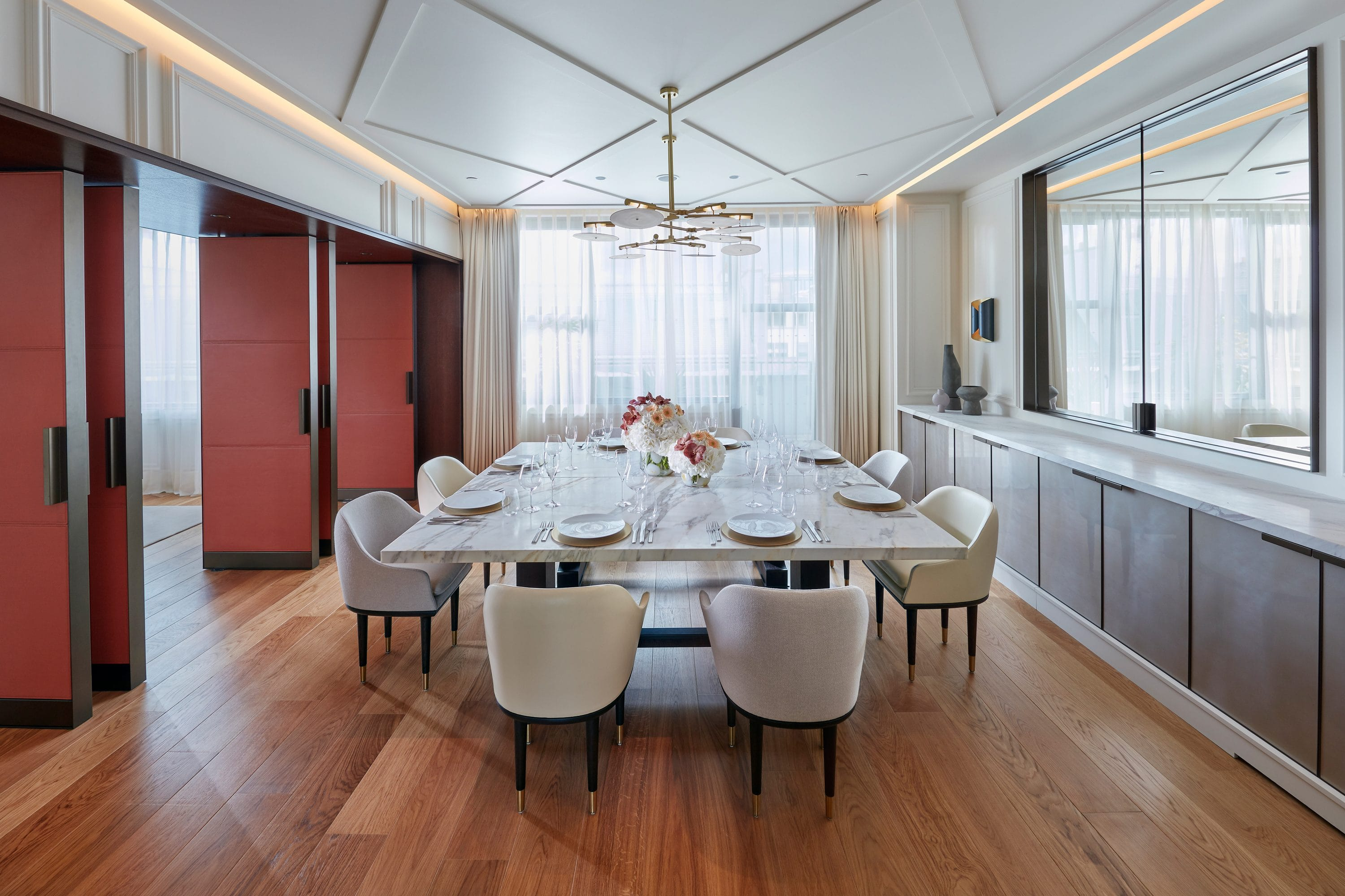 A large table in the private dining room of the Parisian Apartment