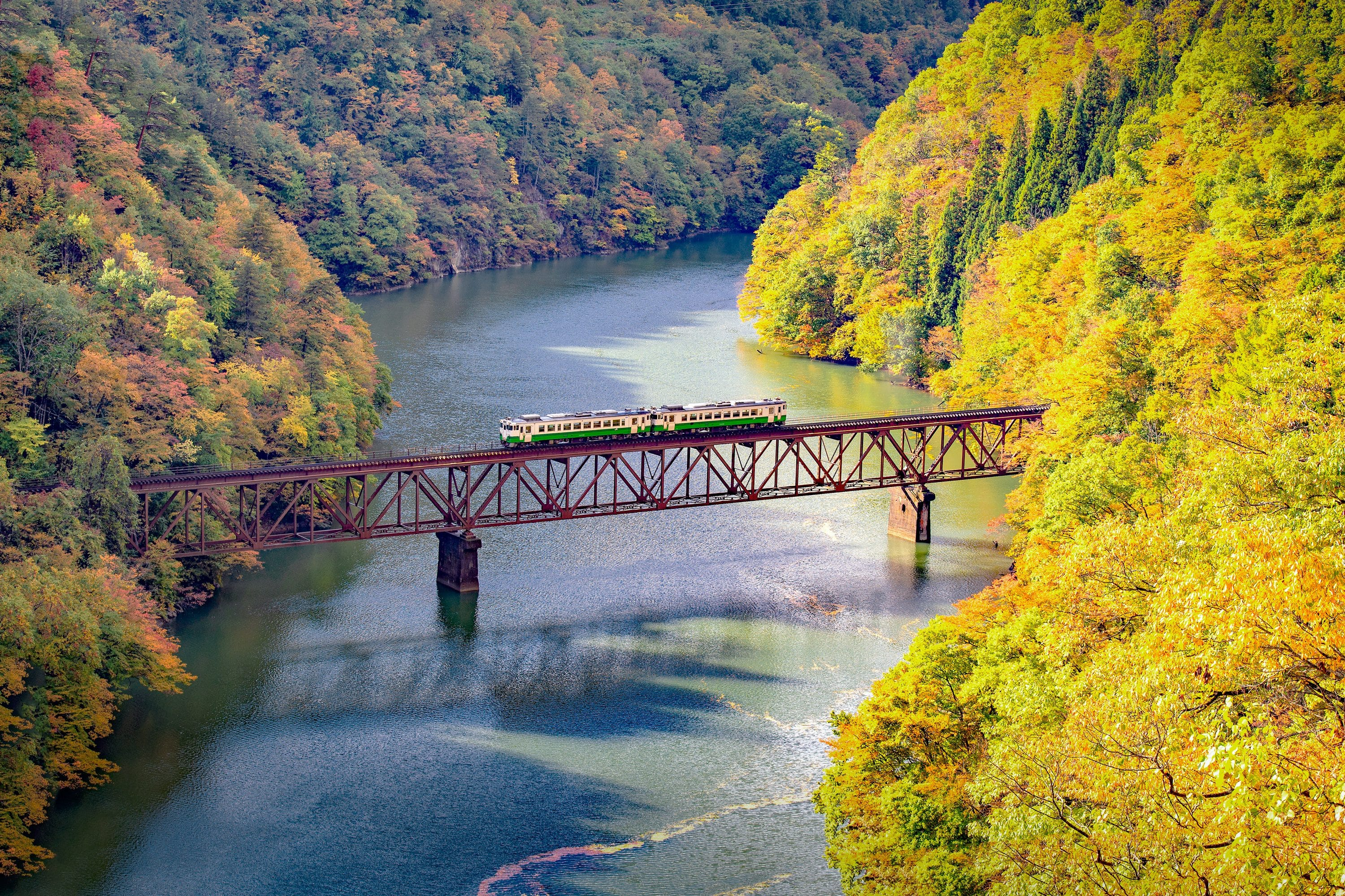 Train on a bridge over a river in Japan