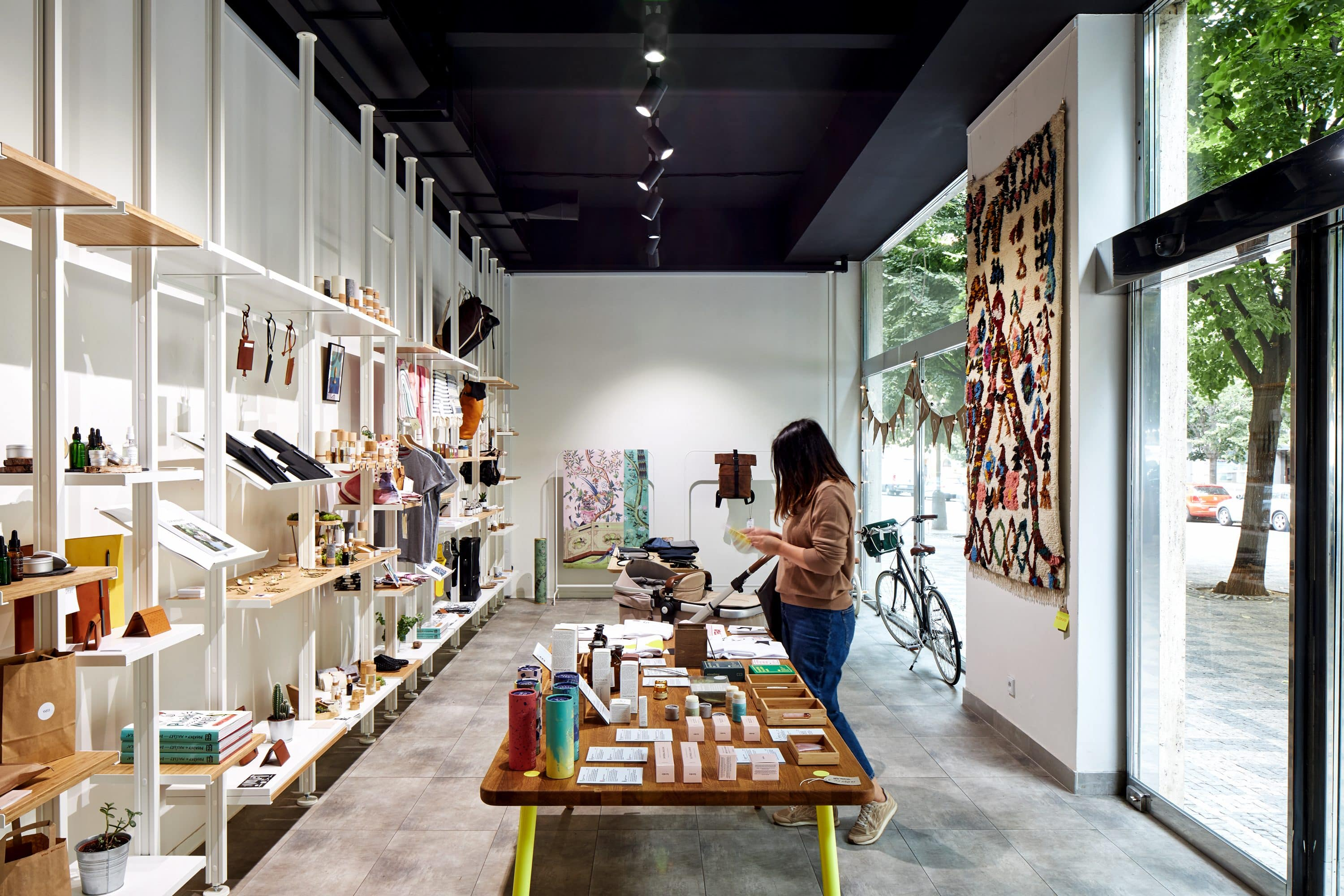 A woman browses design trinkets at Shop Up Stories