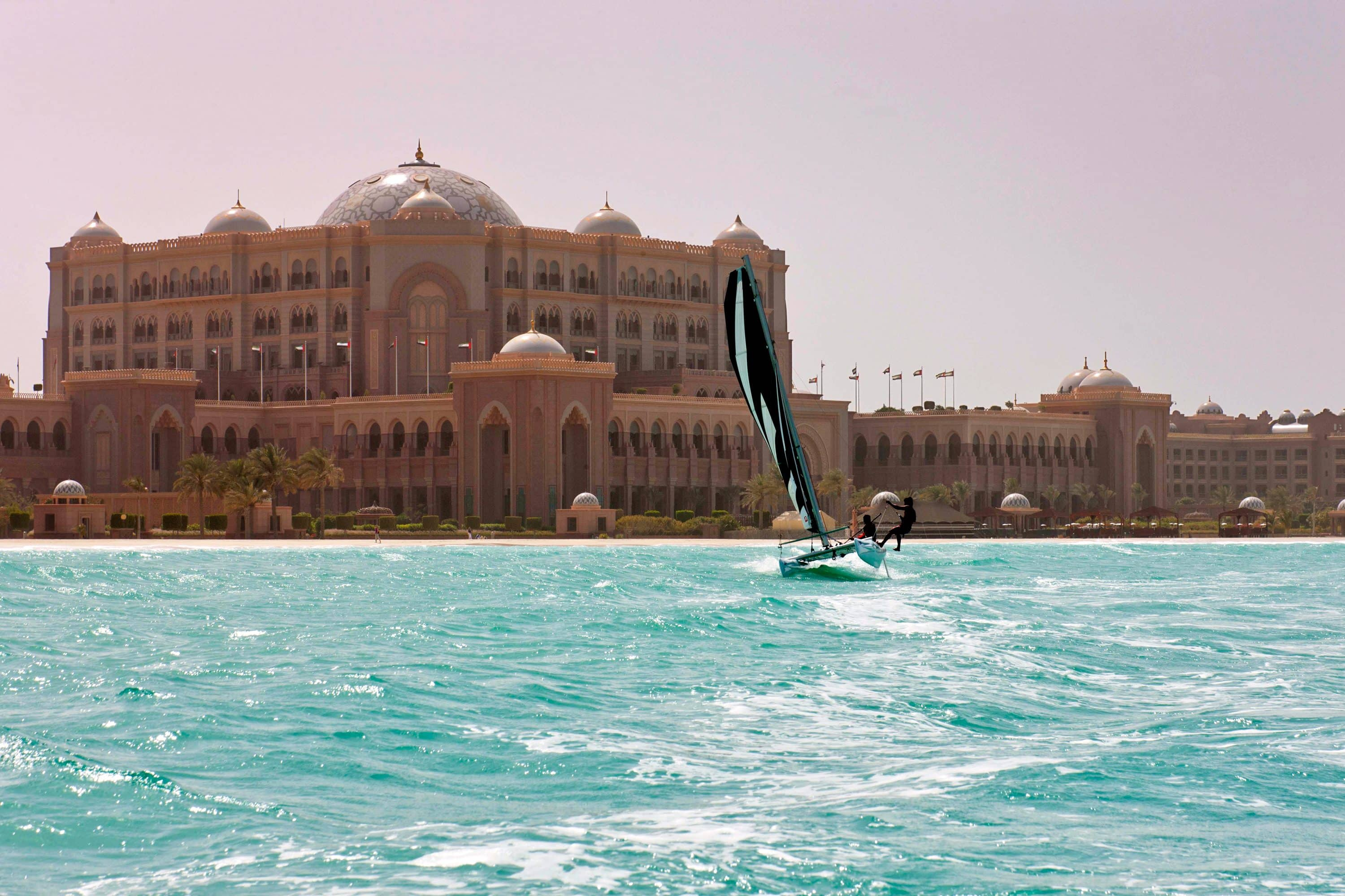 Windsurfer on the water in front of Emirates Palace