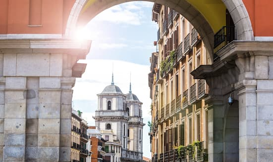 View of Madrid street through archway at Plaza Mayor
