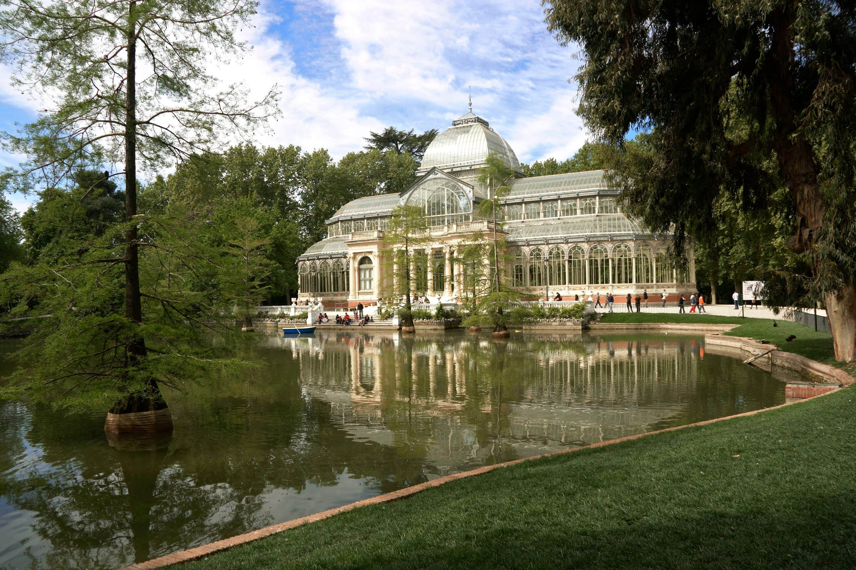 View of The Glass Palace overlooking the water in Retiro Park, Madrid
