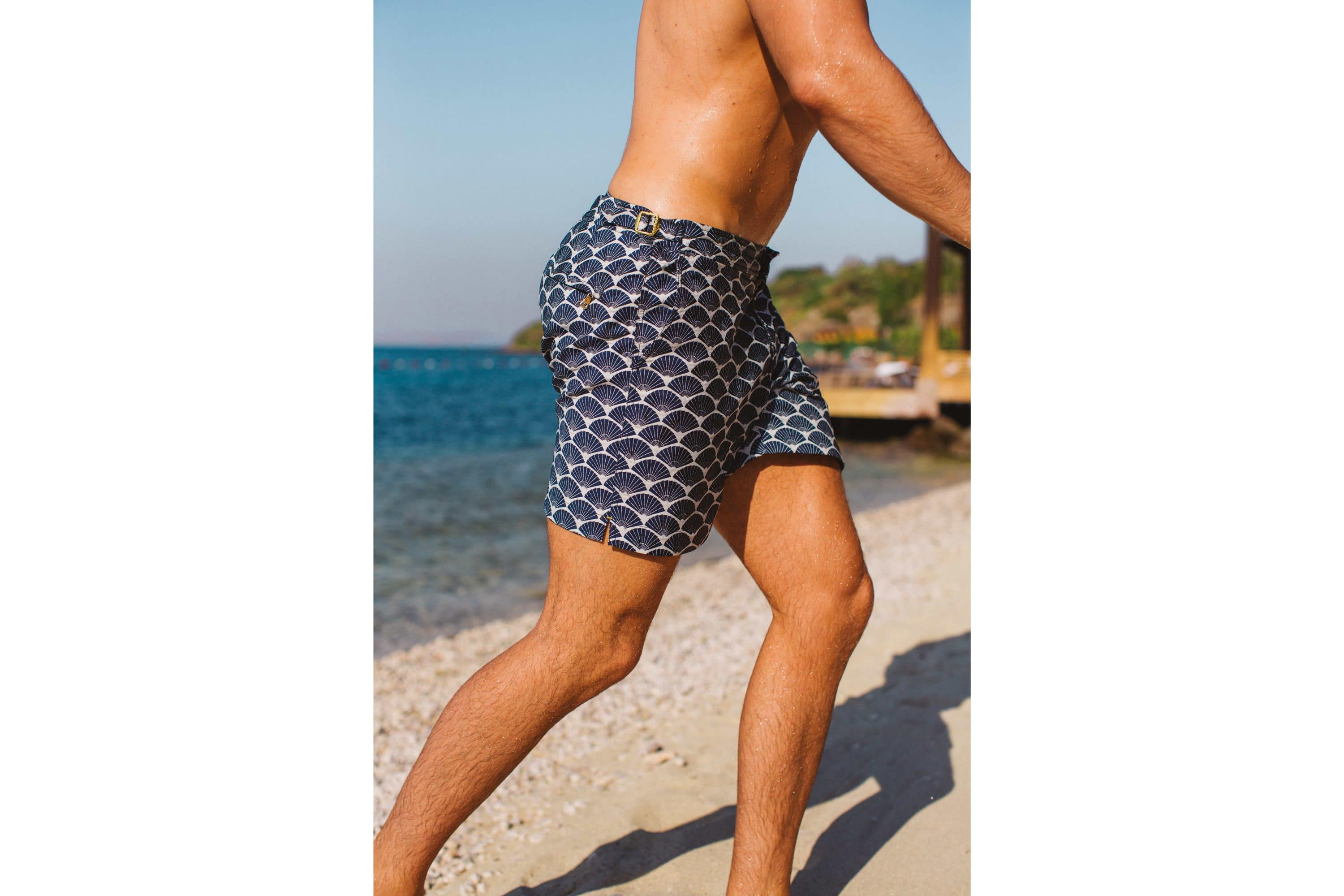 Man running on beach with a pair of Orlebar Brown shorts