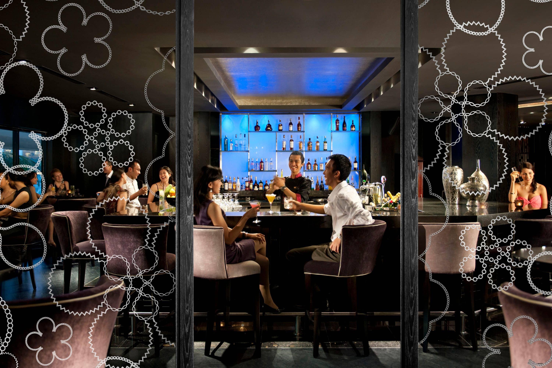 People enjoy cocktails at MO Bar