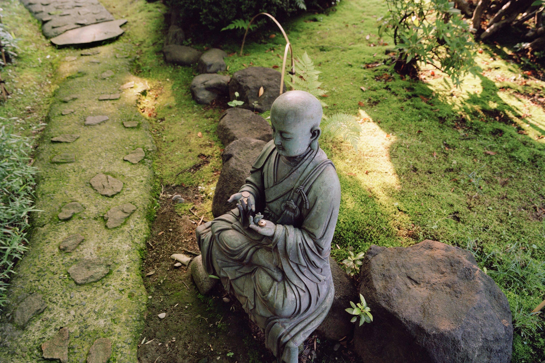 Buddha statue at Tokyo Nezu Museum's Japanese Garden