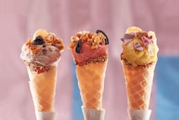Three colourful ice creams on a stand