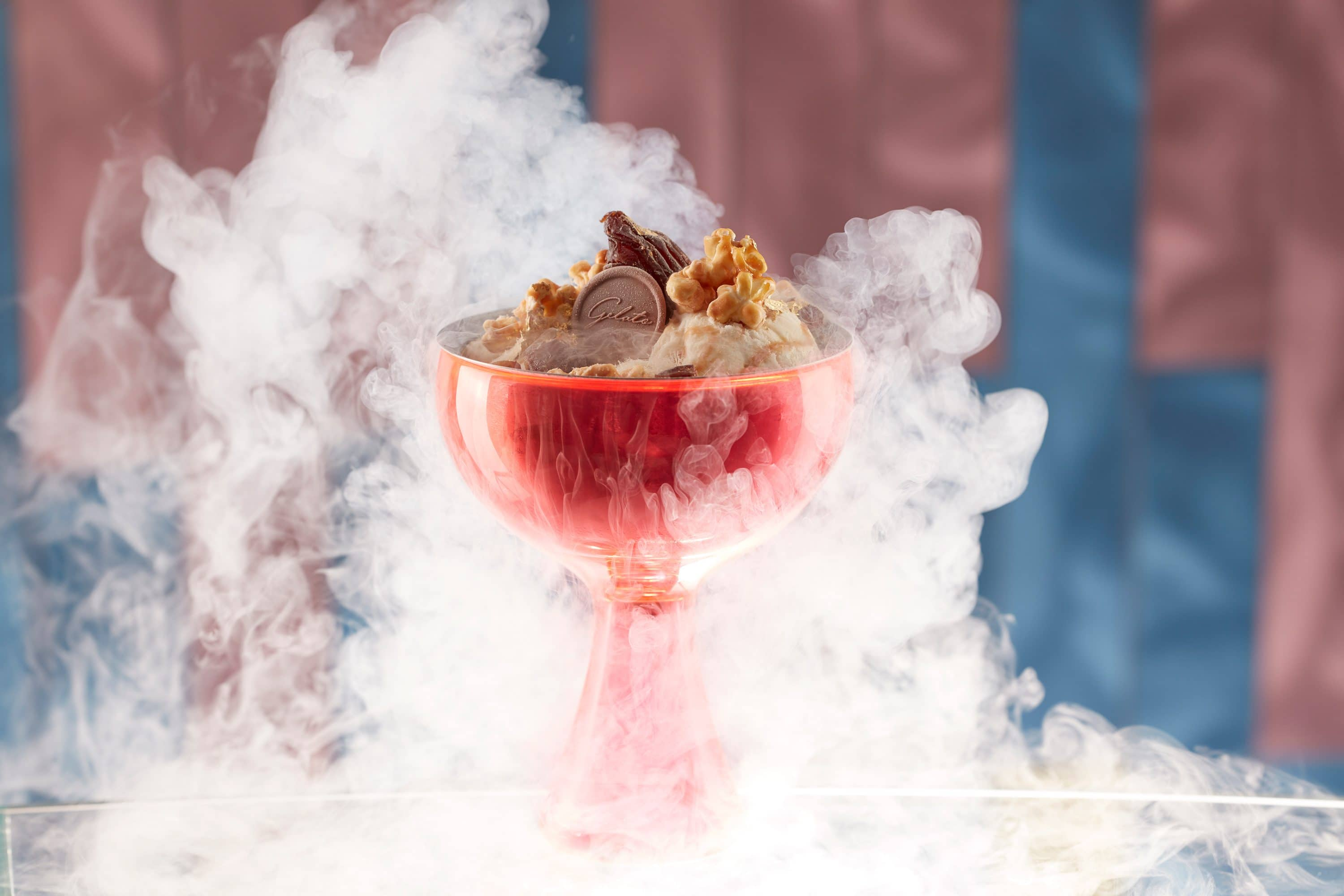 Nitrogen icecreamology dessert with dry ice smoke