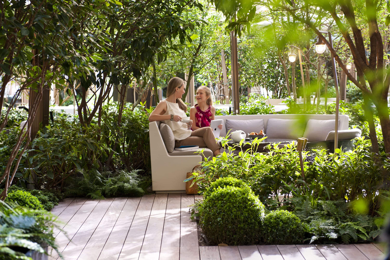 Mother and daughter enjoying the garden at Mandarin Oriental, Paris