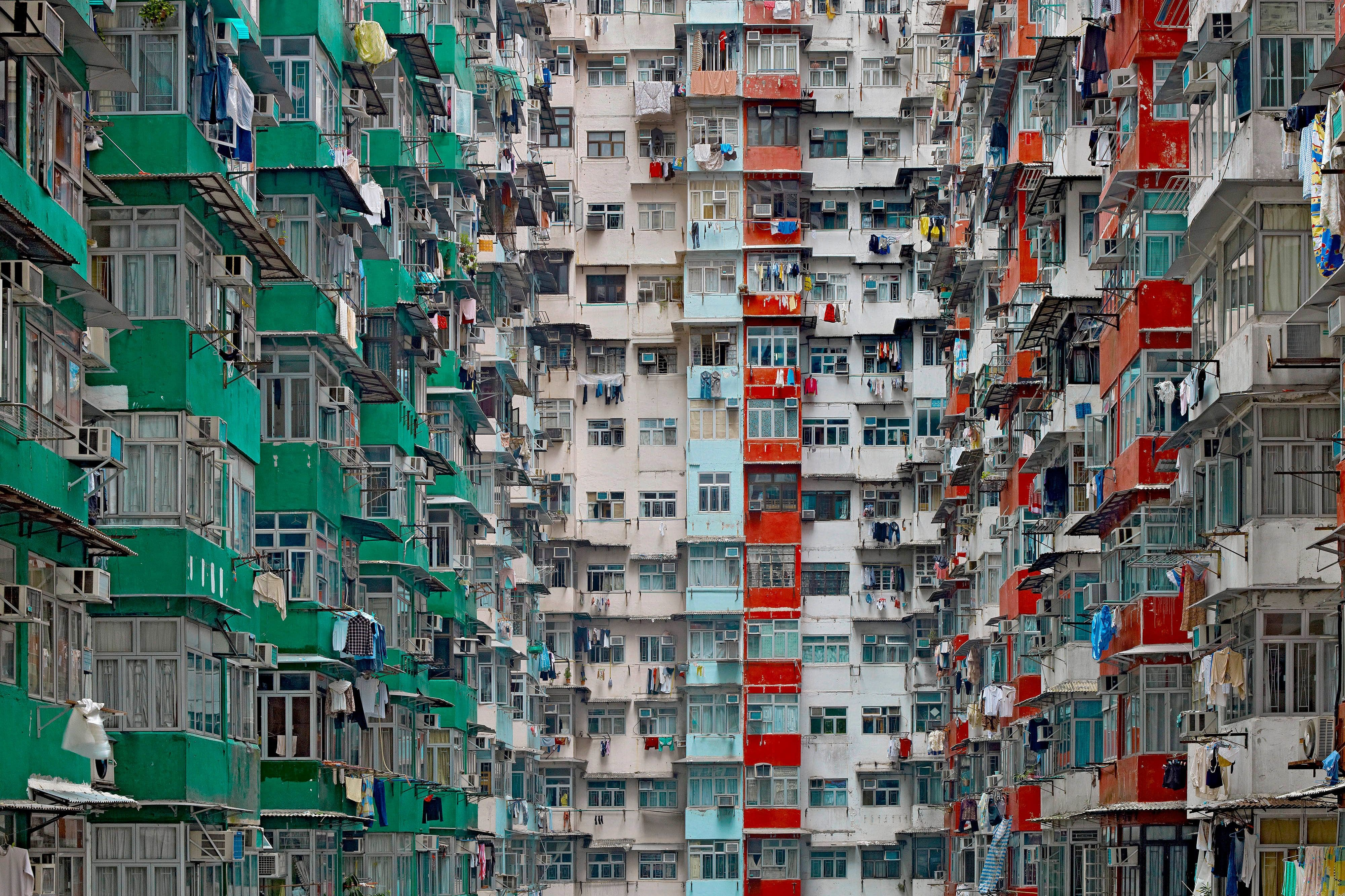 The multicoloured high-rise flats of Hong Kong with green, red and blue balconies