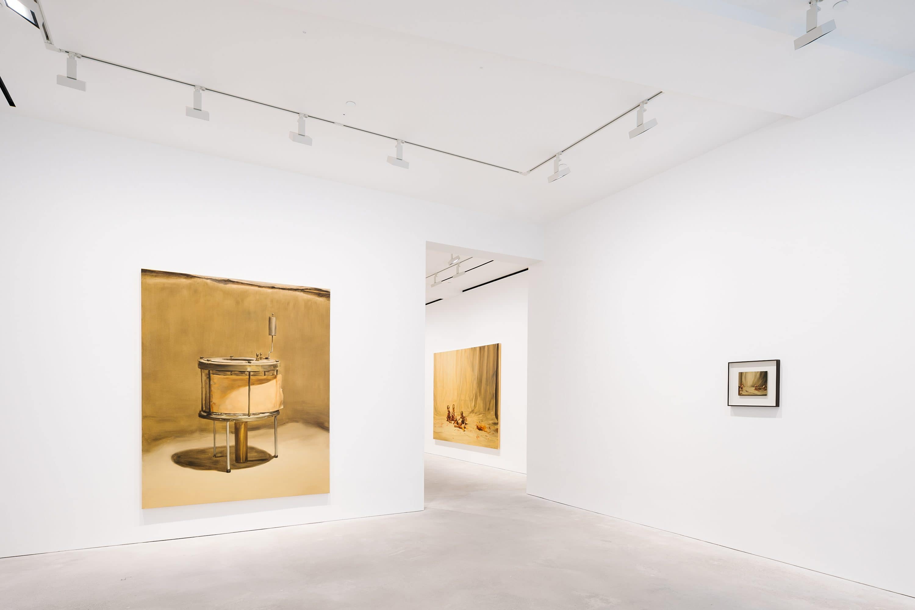 The stark white interior of a gallery is in H Queen's building punctuated by pops of yellow artwork canvases