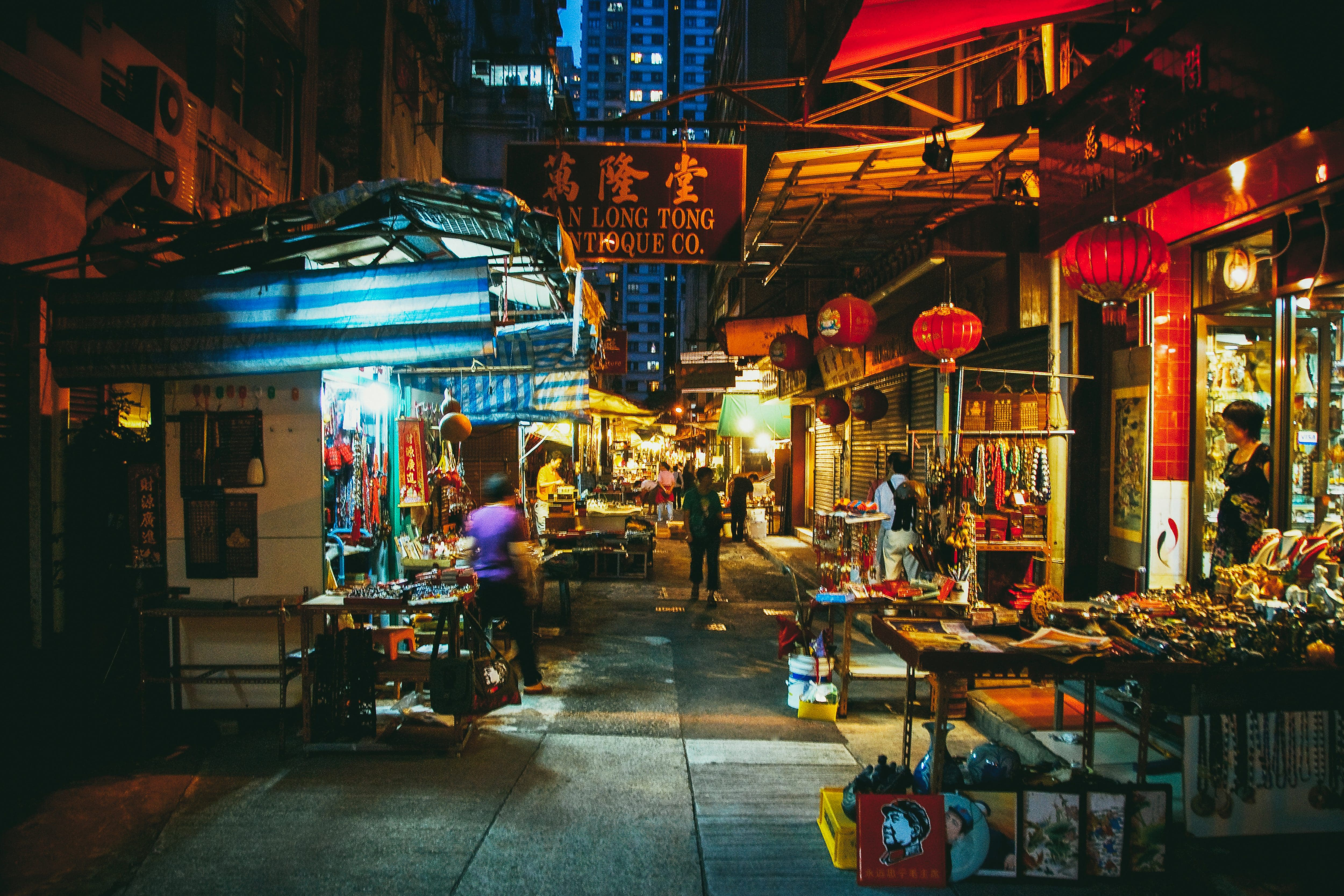 Busy vendors sell their wares from their shop front which overflow into the narrow streets of Sheung Wan