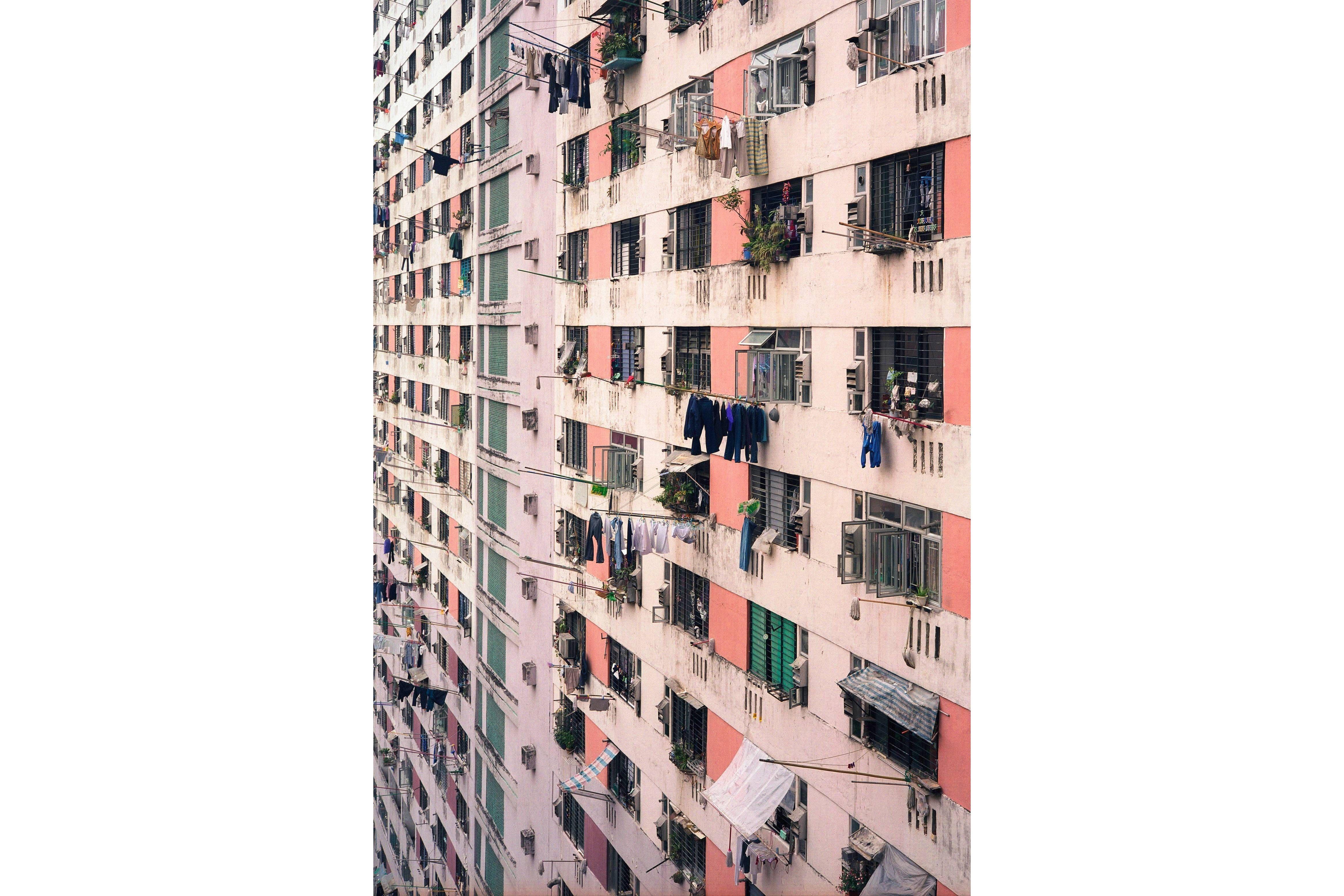 The pink geometric facade of a Hong Kong apartment block