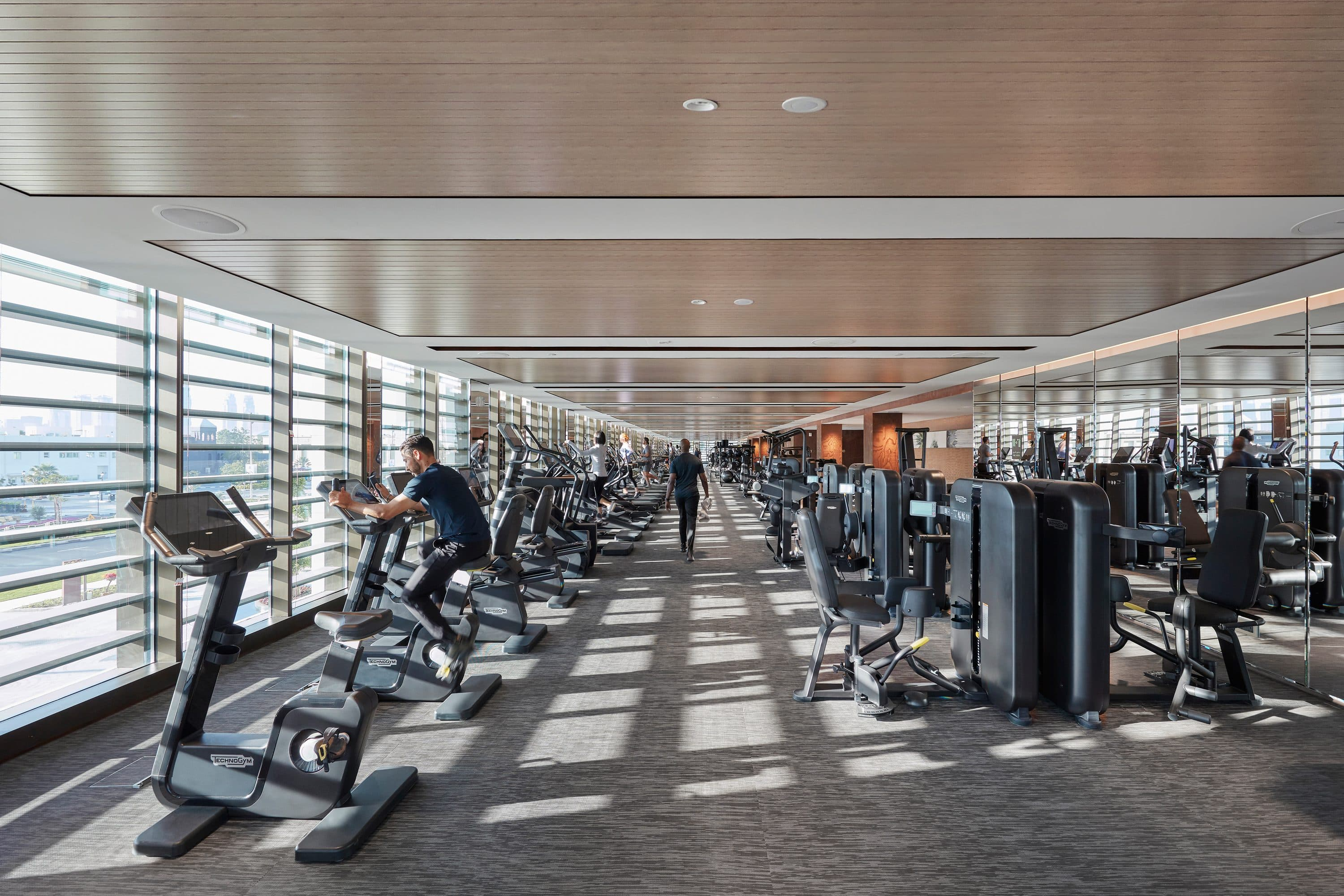 People workout on fitness machines in gym