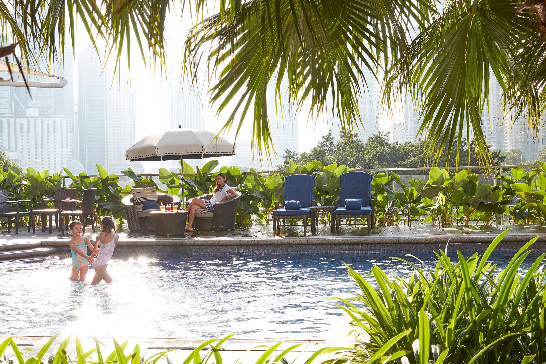 Children play in pool at Mandarin Oriental, Kuala Lumpur