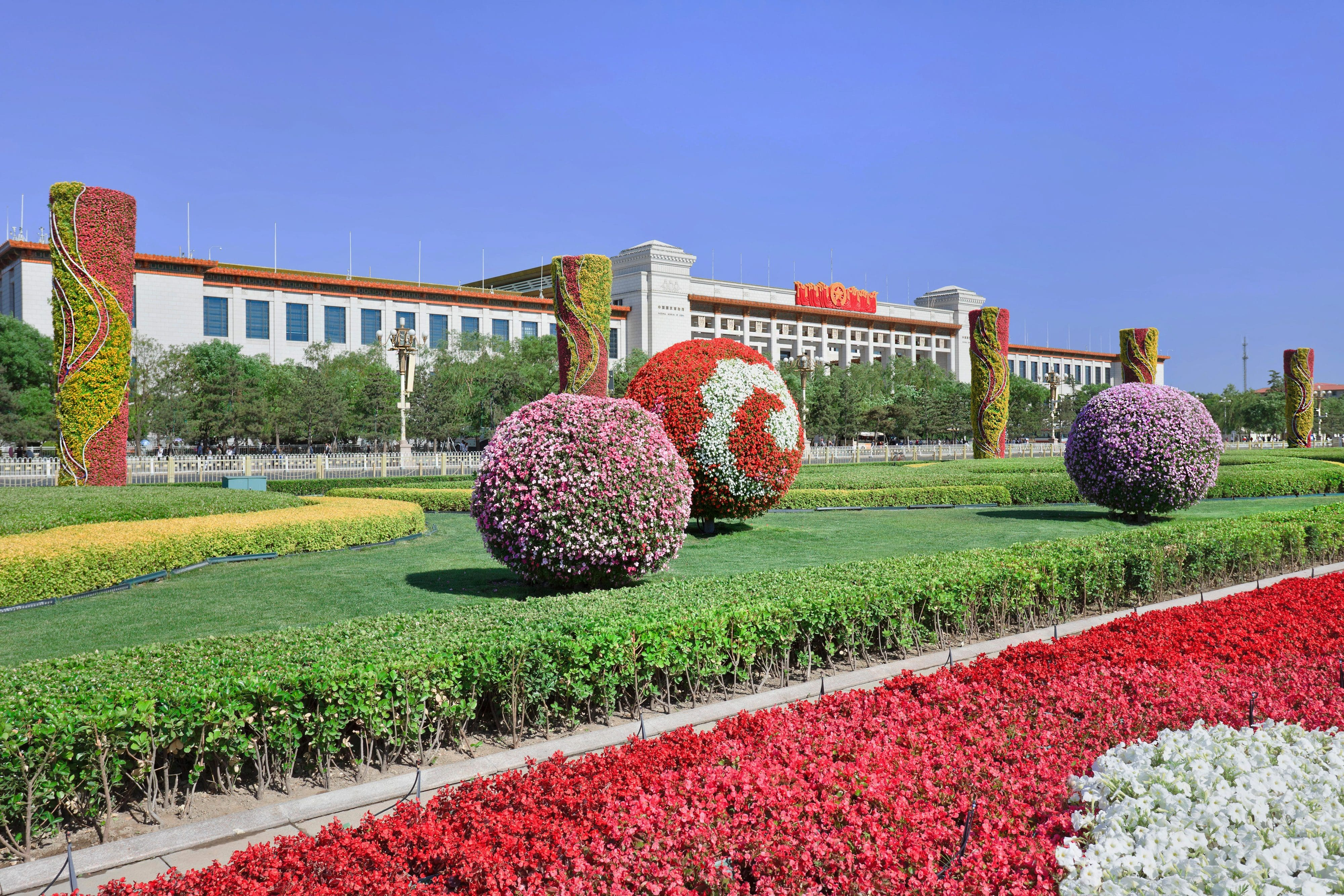 Verdant gardens in front of the National Museum of China