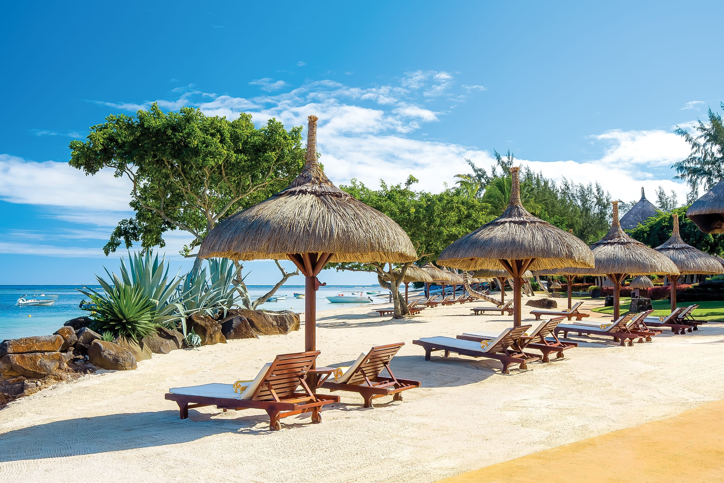 Private beach with loungers at The Oberoi Beach Resort, Mauritius