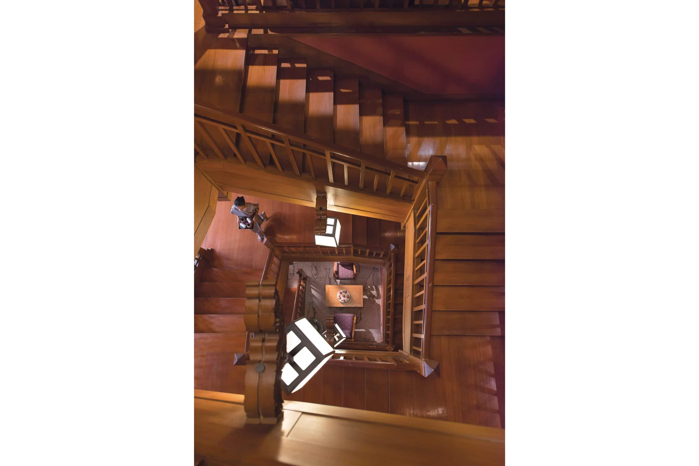 Wooden staircase winding down into the Spa at Mandarin Oriental, Bangkok