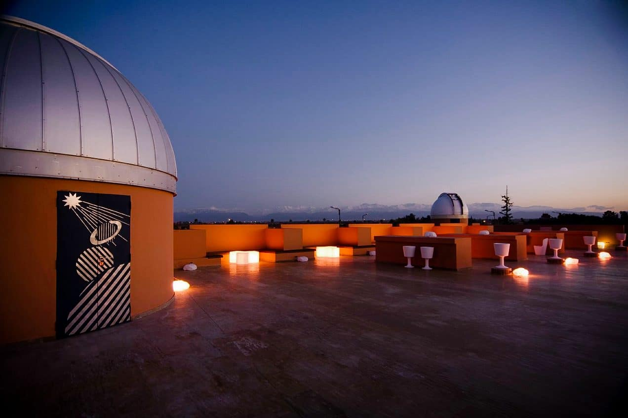 View from the orange-hued roof of Marrakech observatory at night