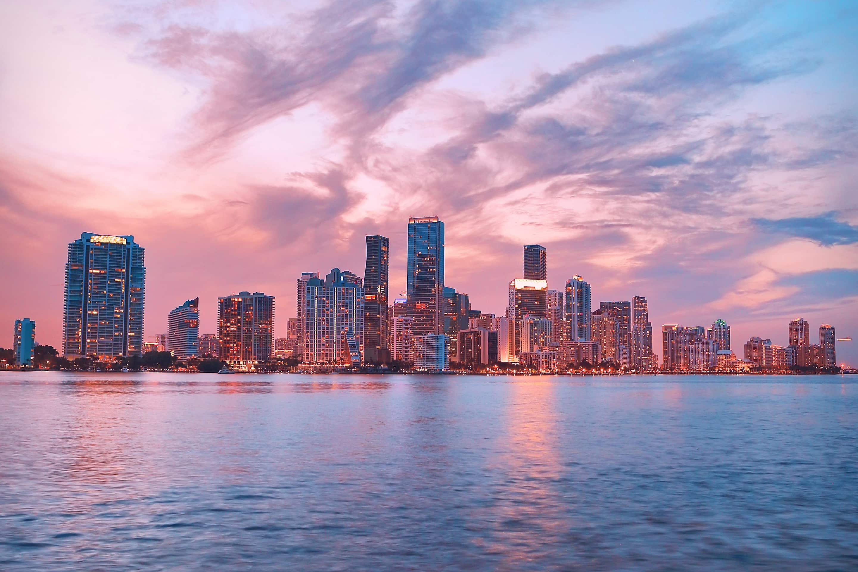 The Miami skyline at night from the water
