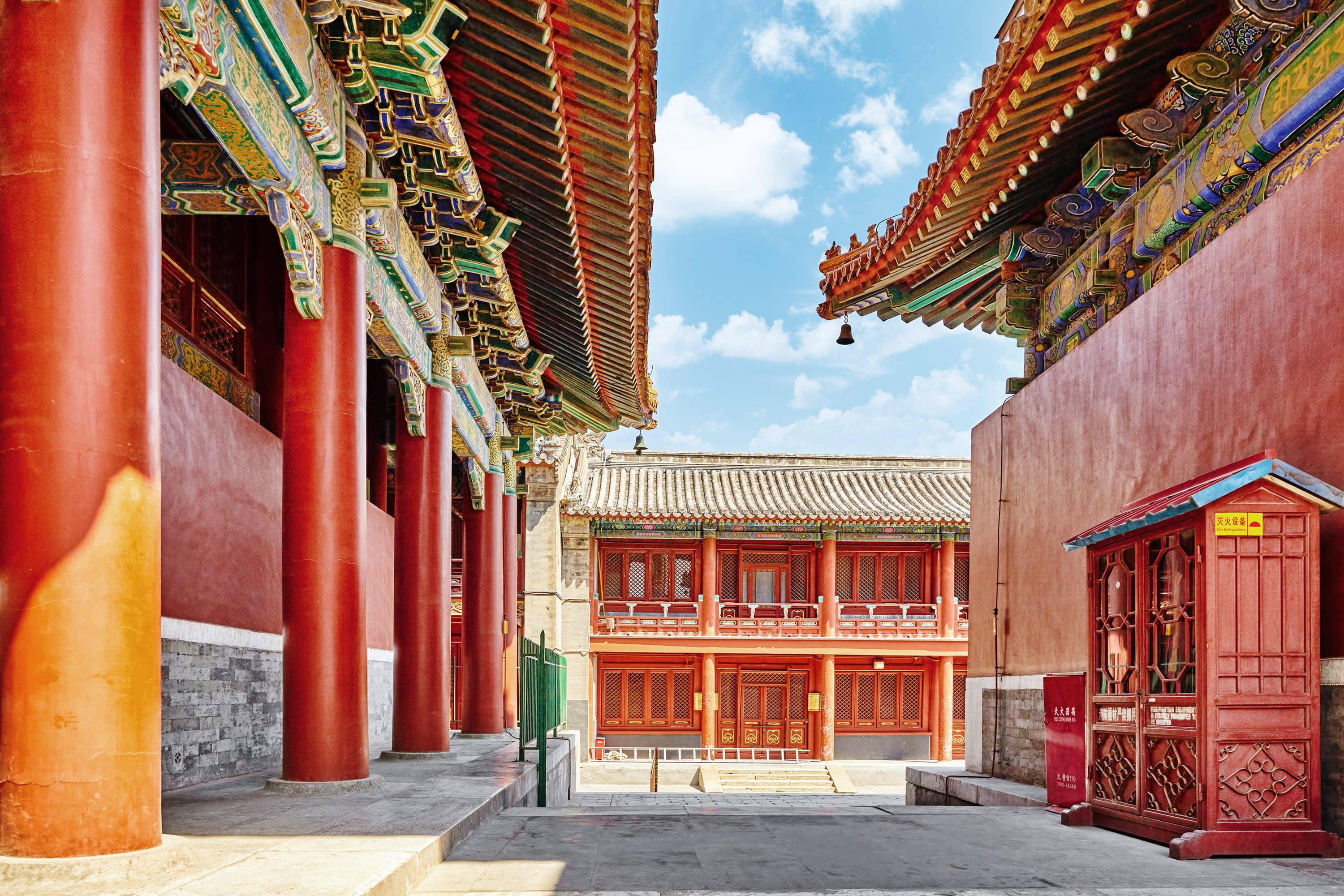 The yellow glazed tiles and red walls of Lama Temple, Beijing