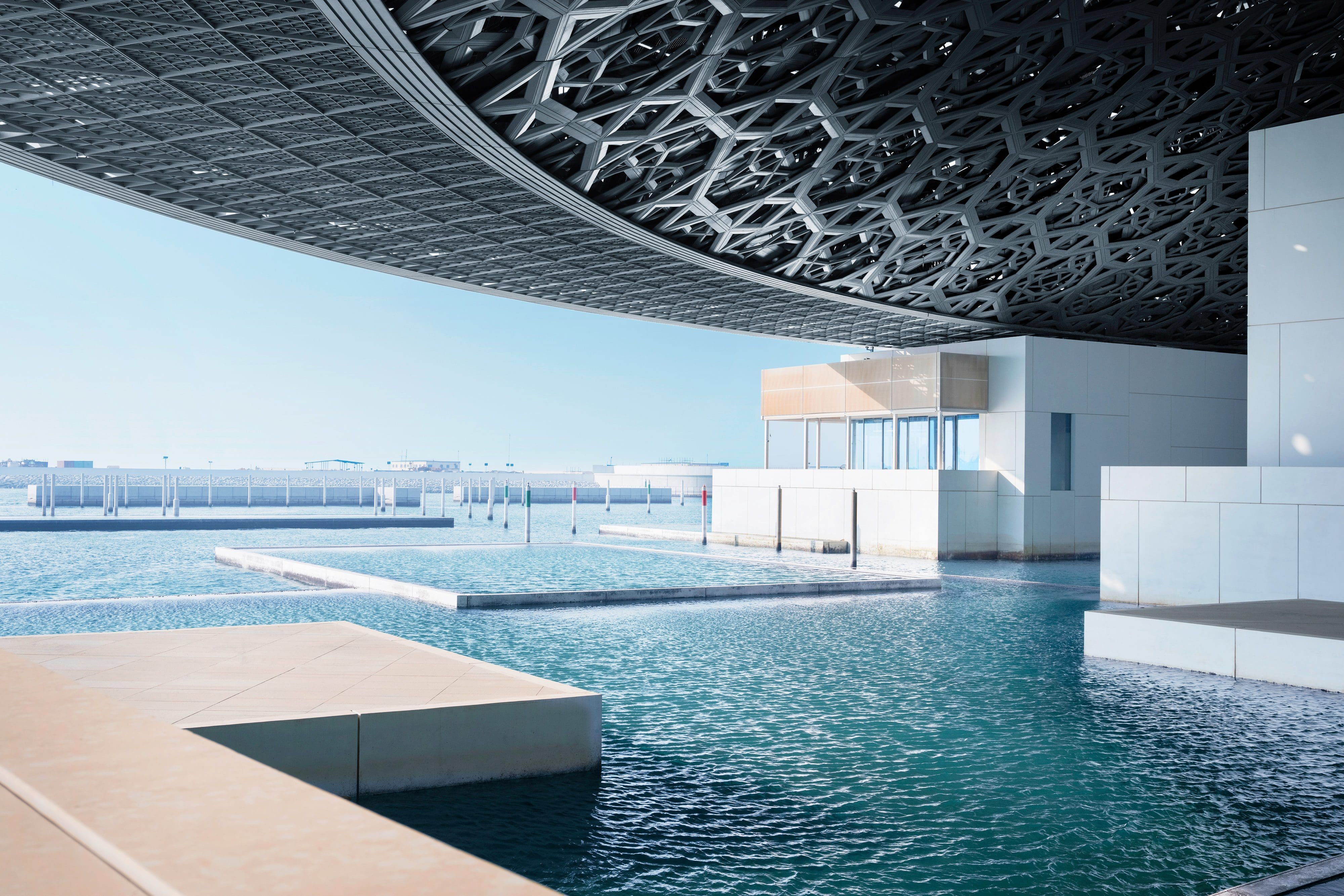 The external pools and intricate roof at Abu Dhabi's Louvre Museum