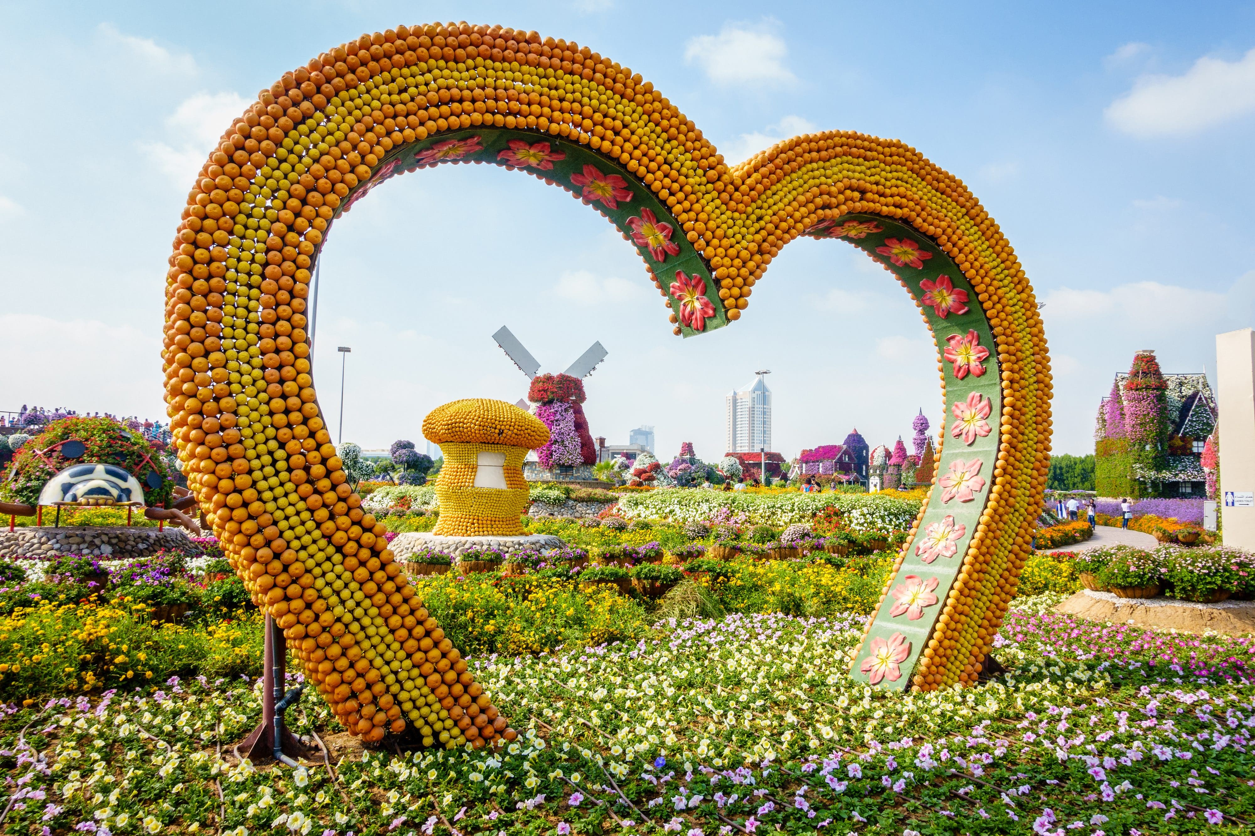 A heart made of fruit and a windmill made of flowers at Miracle Garden