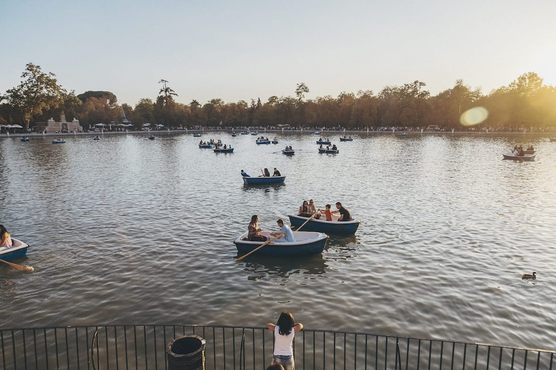 People row on water at Estanque Grande del Retiro