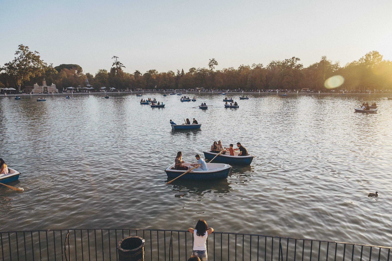 People row on water at Estanque Grande del Retiro