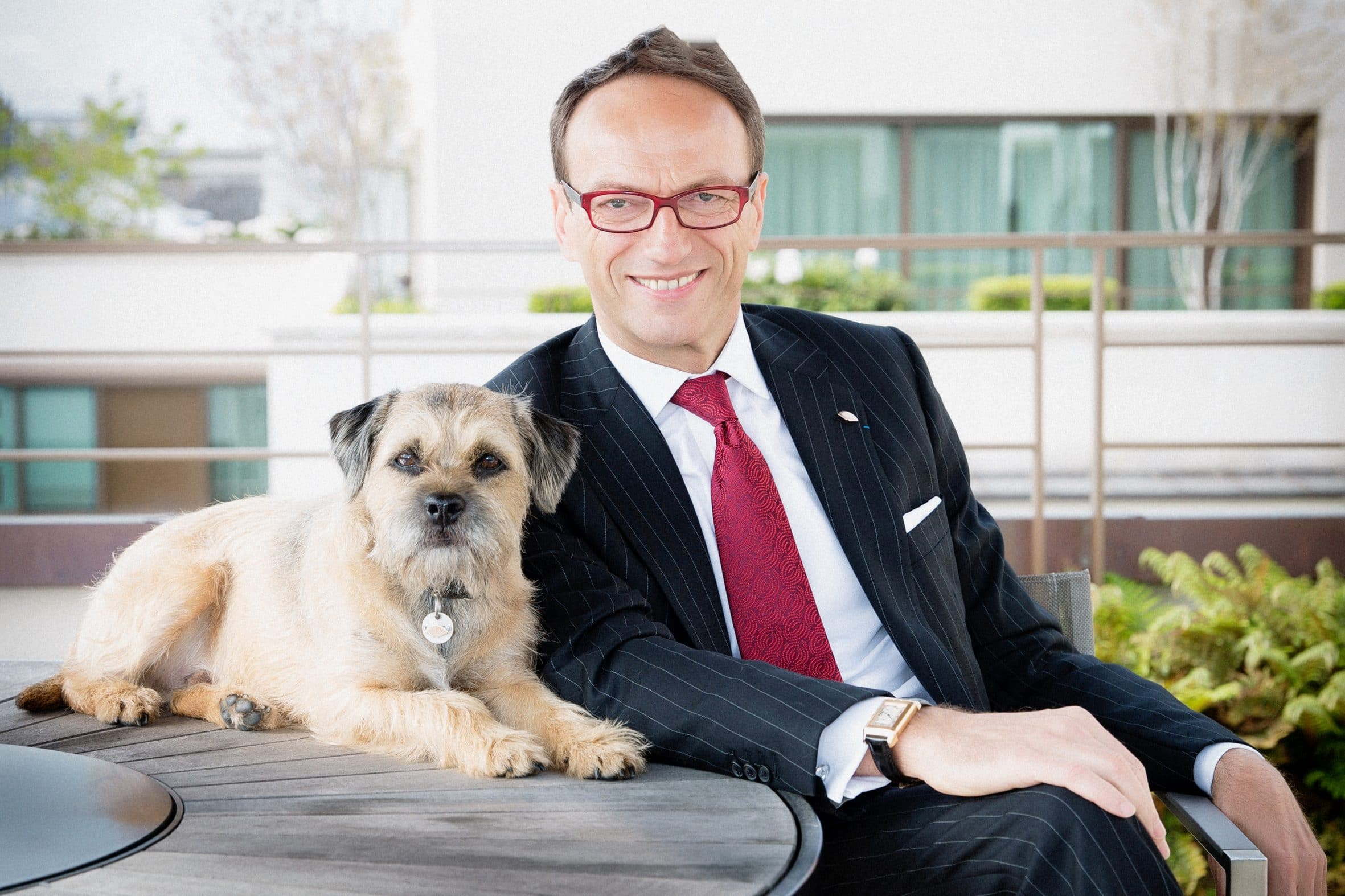 Archie Lewoof sitting with his owner, Philippe Leboeuf