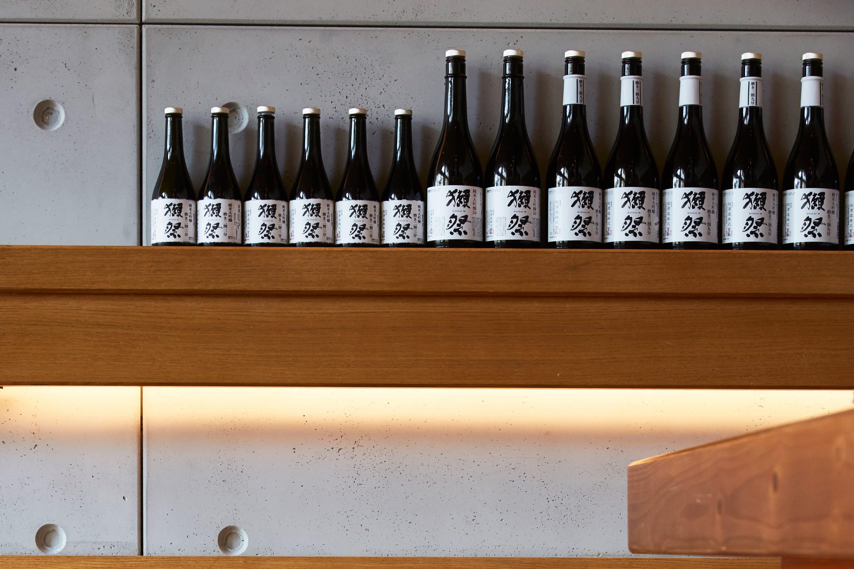 Sake bottles lined up on a shelf