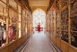 Shopping arcade with large red Christmas tree