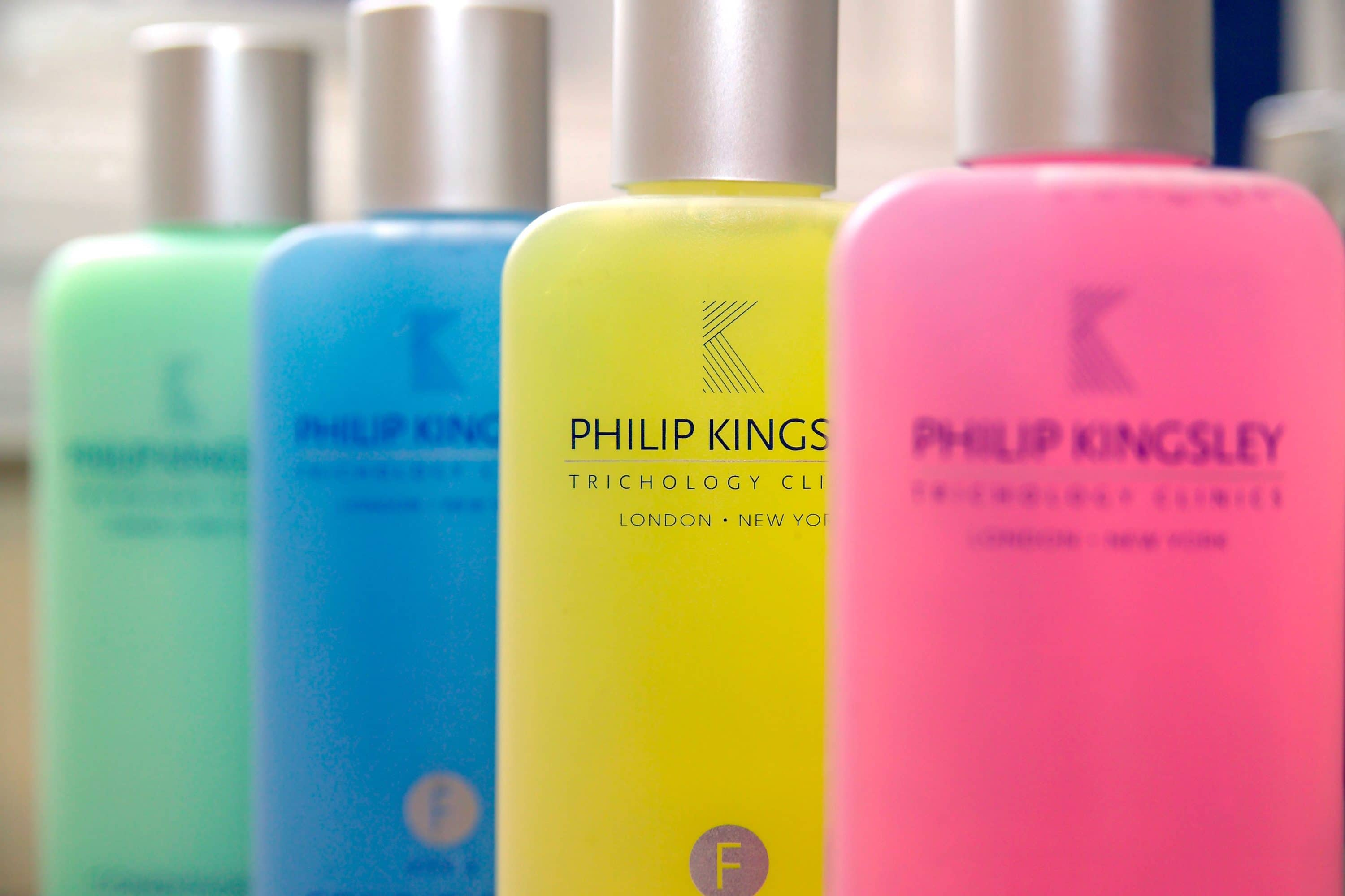 Brightly coloured Philip Kingsley haircare product bottles