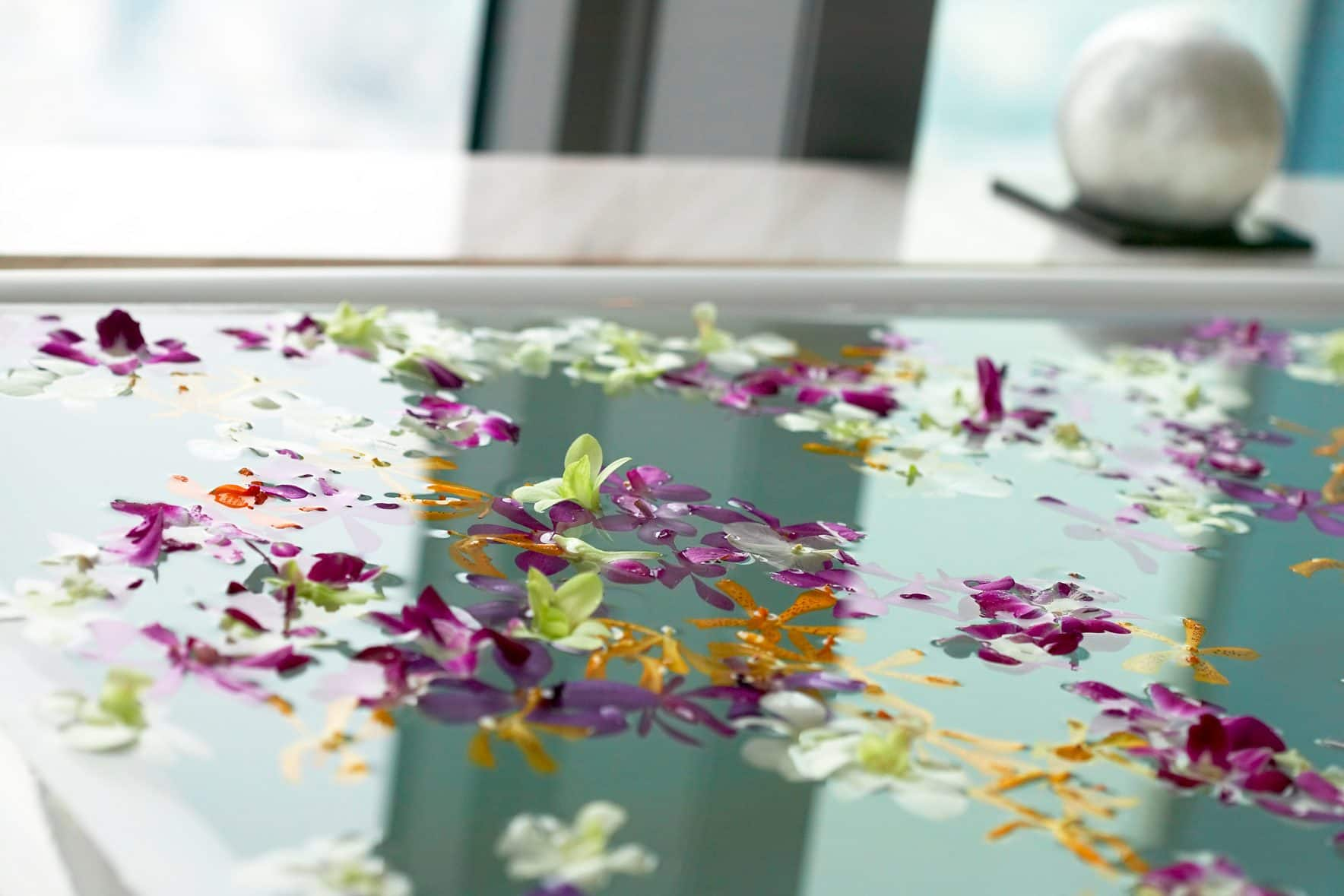 Bath with flowers petals in the tranquility suite at the spa at Mandarin Oriental, Tokyo
