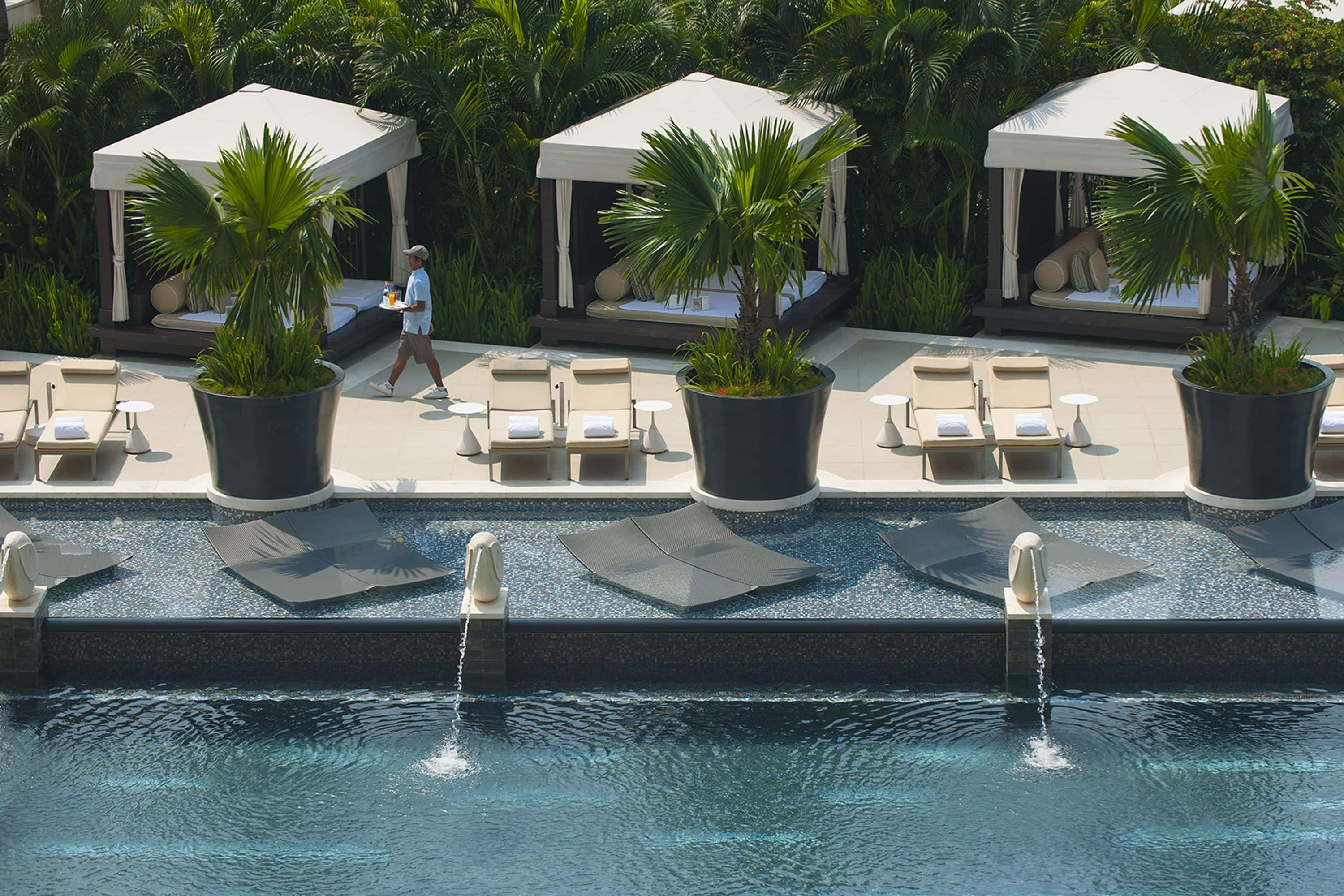 The pool and poolside cabanas at Mandarin Oriental, Singapore