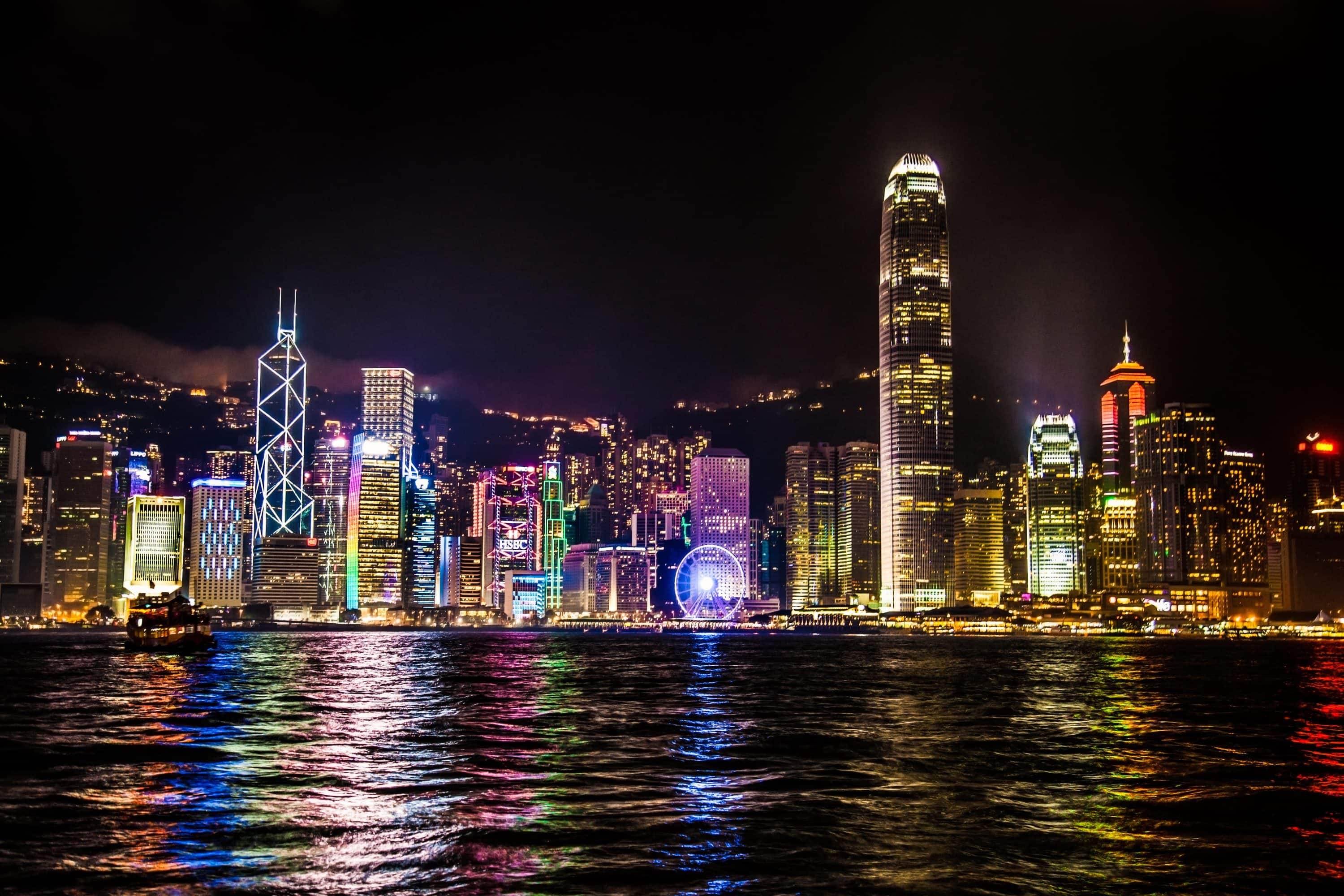 A view of the illuminated harbourfront from the water in Hong Kong
