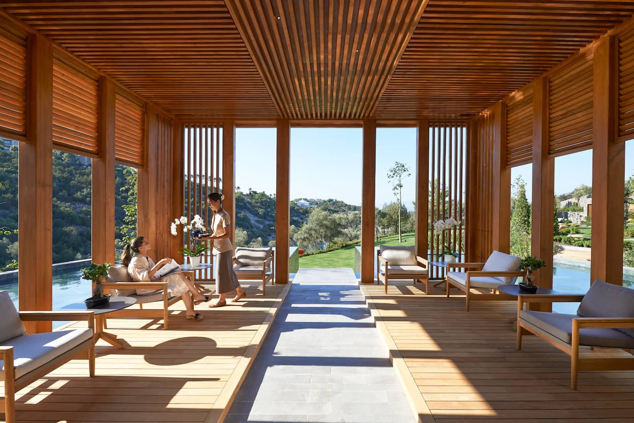 The calming tea lounge at the spa at Mandarin Oriental, Bodrum with it's natural wood, easy chairs and garden views