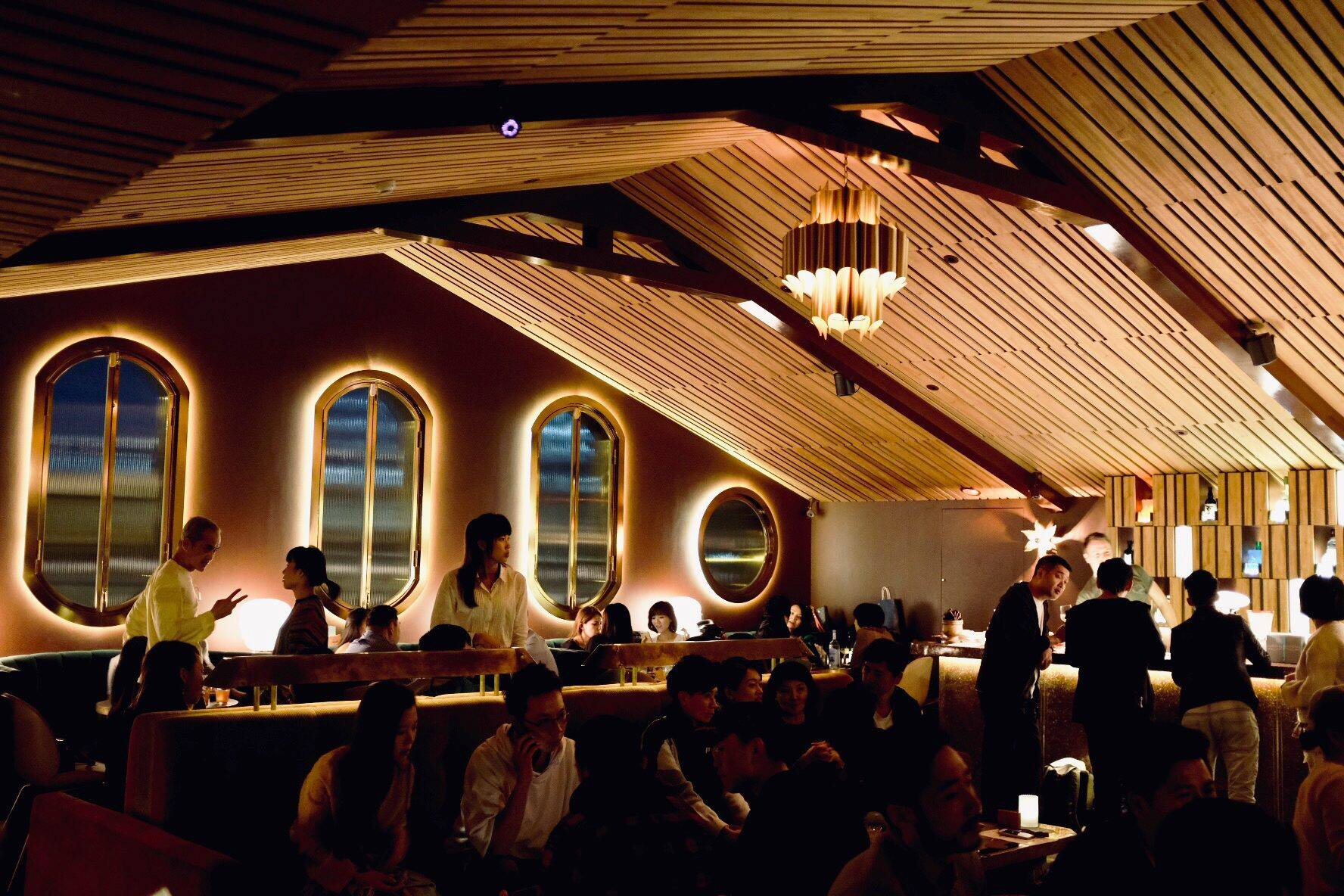 Visitors inside dimly-lit Staff Only speakeasy bar
