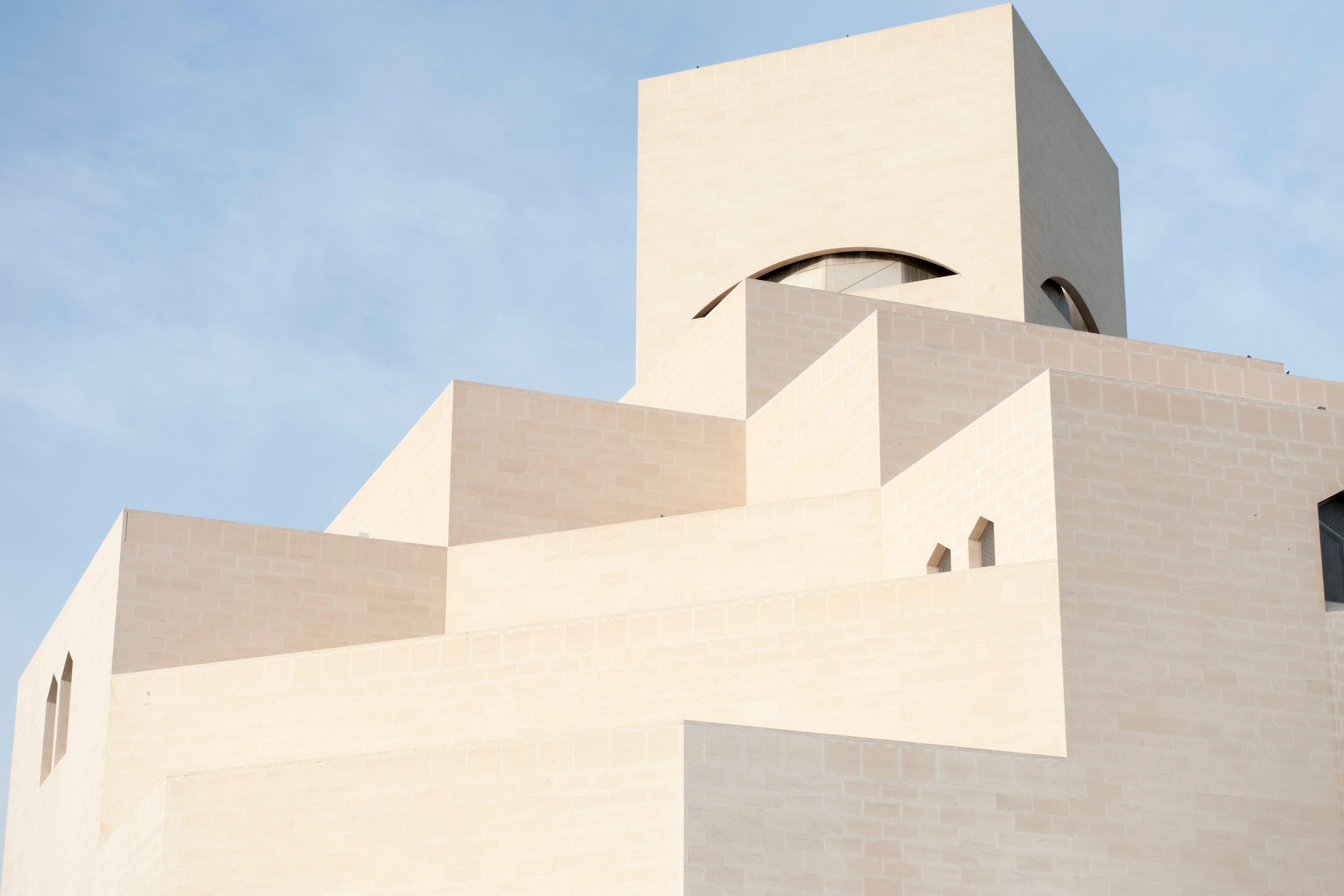 The exterior of minimalist, pure white Museum of Islamic Art