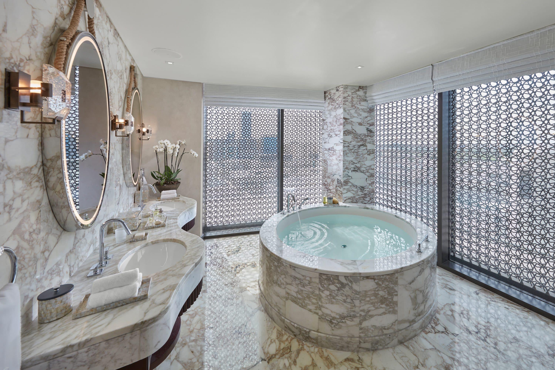Bathroom with oval tub at Mandarin Oriental, Doha