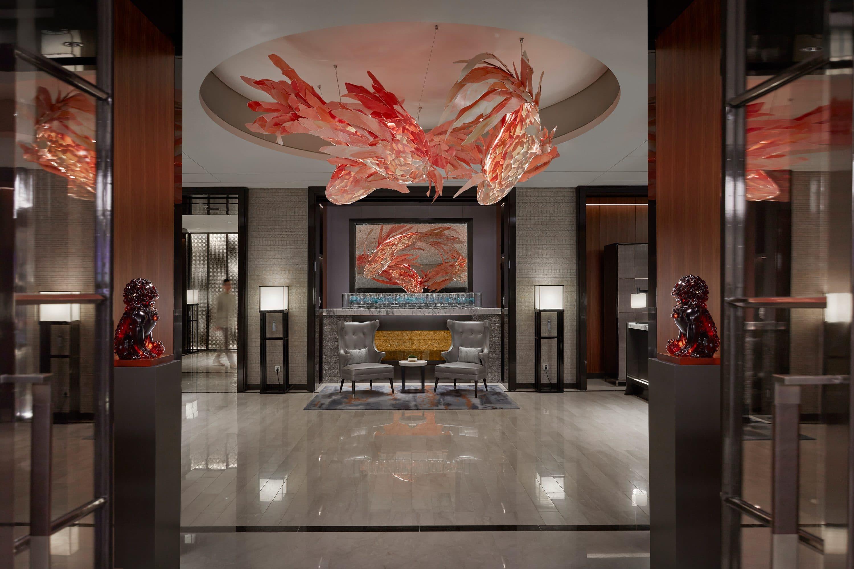 Pink peach fish sculpture at hangs in the lobby of Mandarin Oriental Wangfujing, Beijing