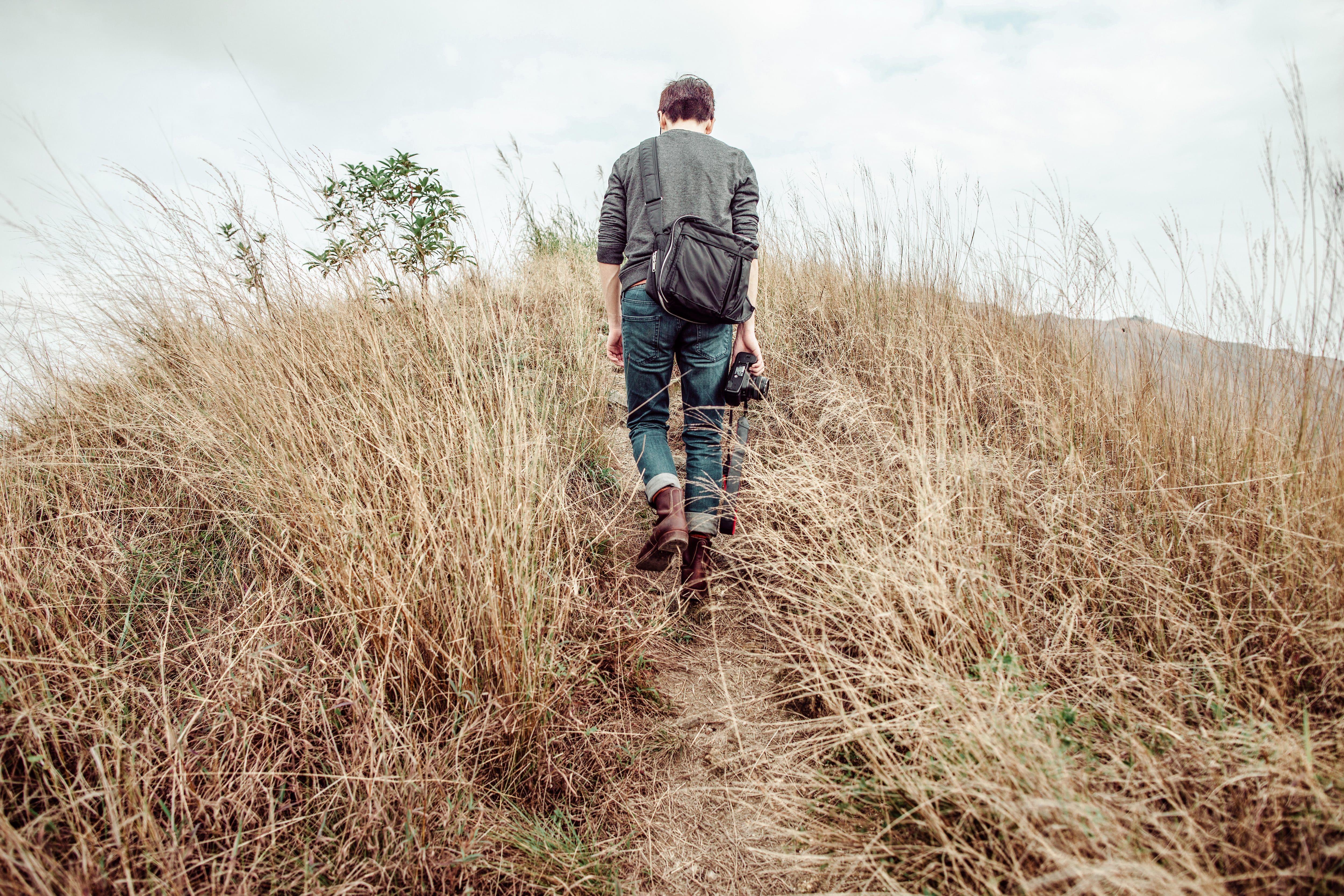 Man walking on mountain top